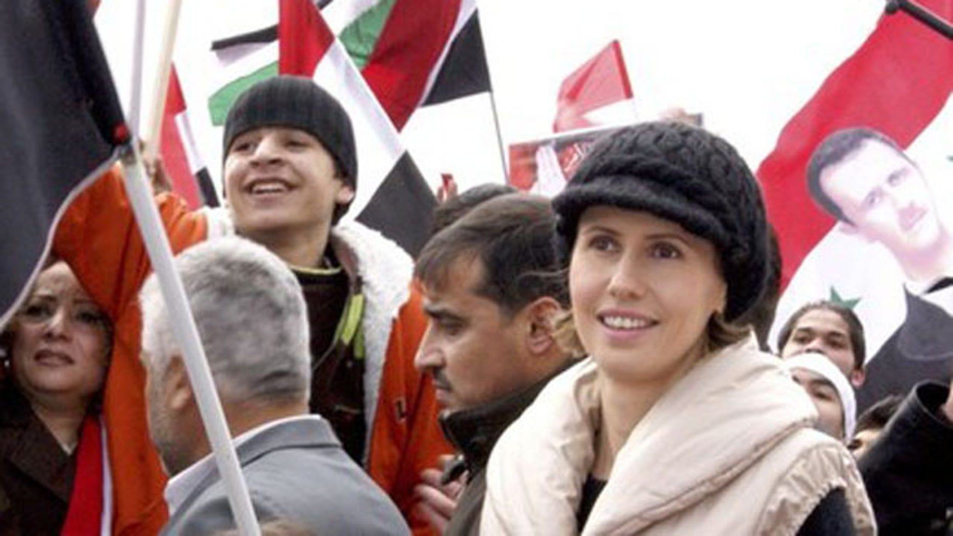 Jan. 11, 2012: Asma, the wife of Syrian President Bashar al-Assad, makes an appearance during a rally in support of her husband in Damascus.