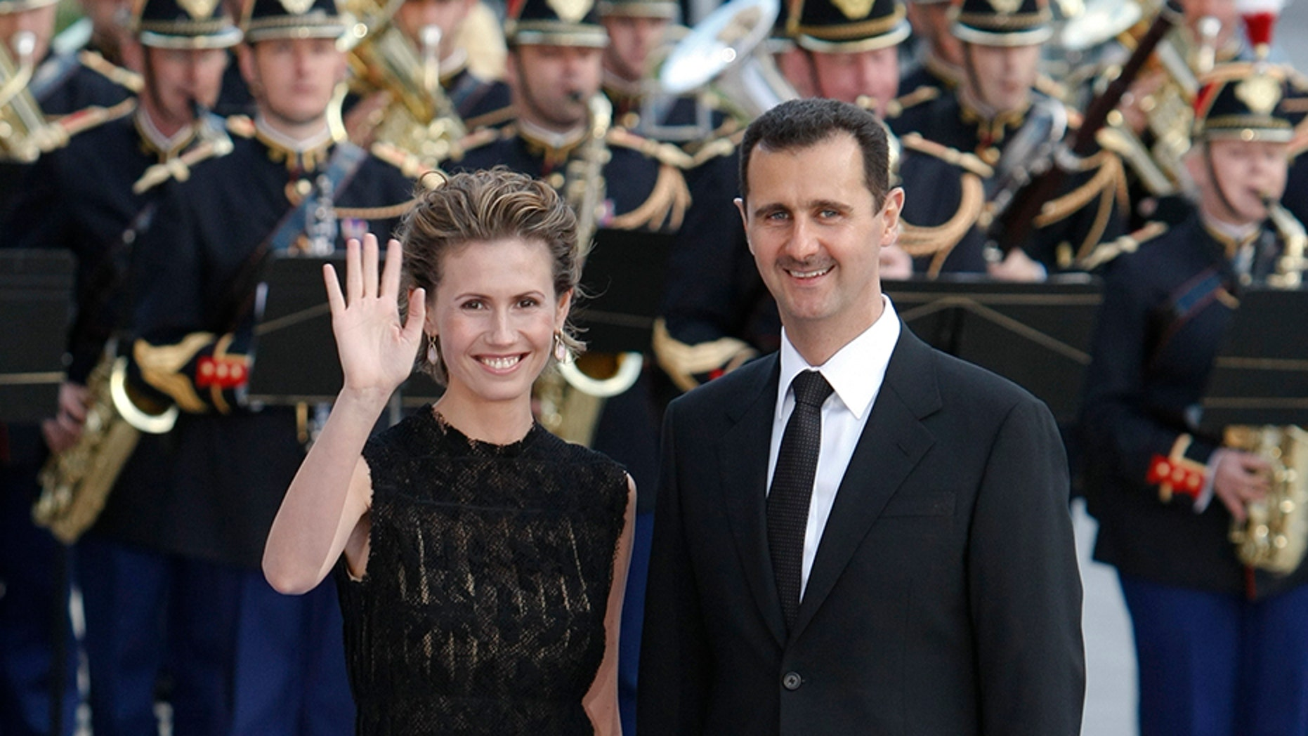 July 13, 2008: Syria's President Bashar Al-Assad and wife Asma arrive at a dinner during a EU-Mediterranean summit in Paris.