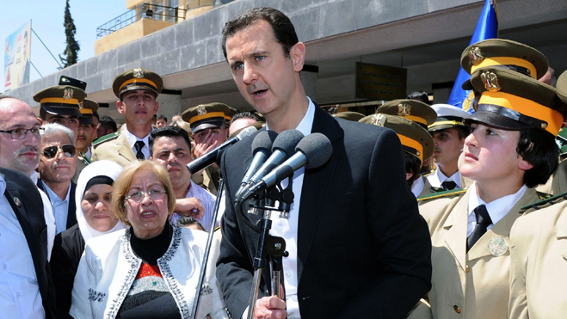 May 6, 2015: In this photo released by the Syrian official news agency SANA, Syrian President Bashar Assad speaks during a public appearance at a school in Damascus, Syria.