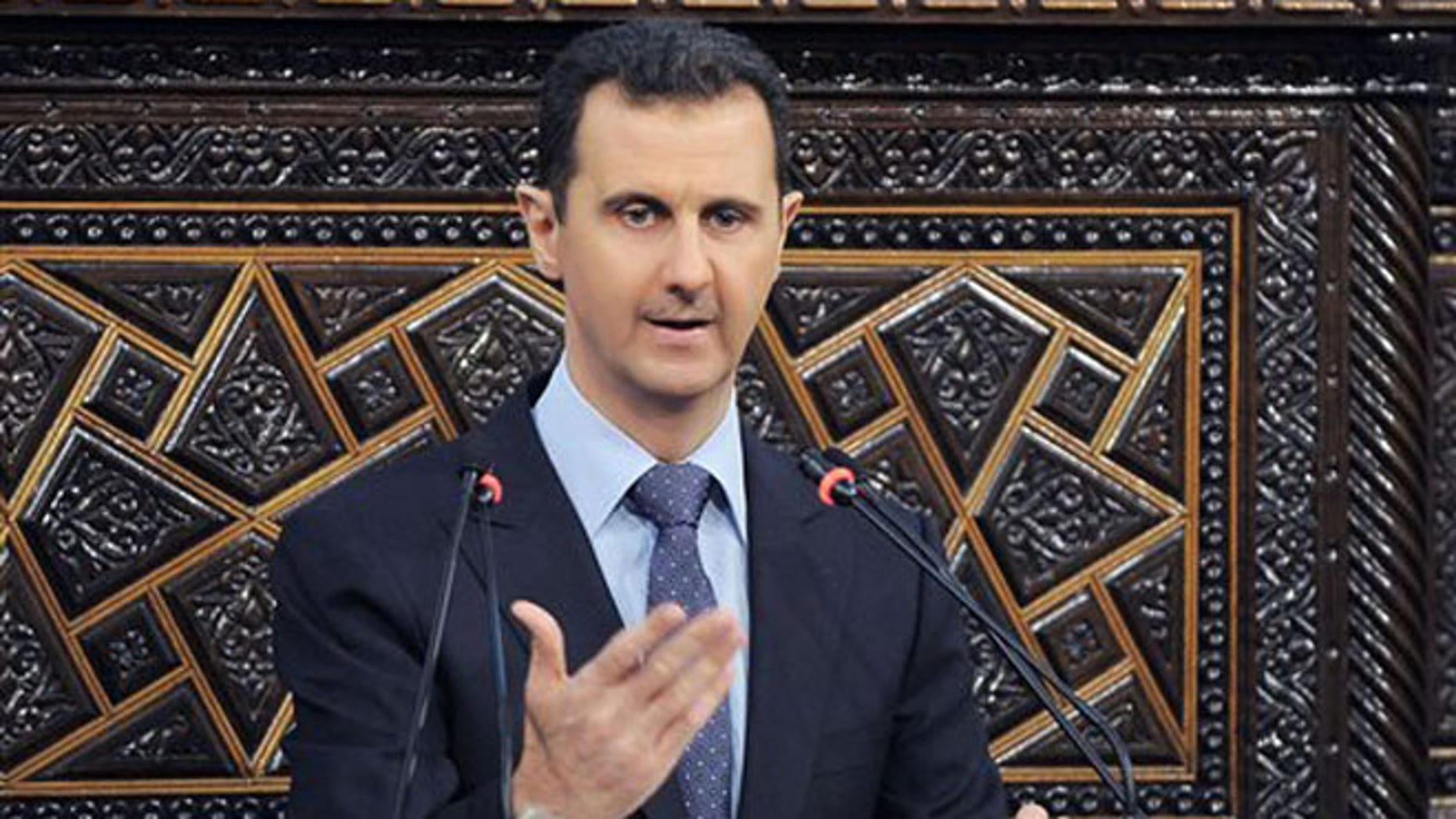 """June 3, 2012: In a much-anticipated speech, embattled Syrian president Bashar al-Assad blames foreign powers and """"terrorists"""" for the violence that has wracked the country for the last 15 months. (AP)"""