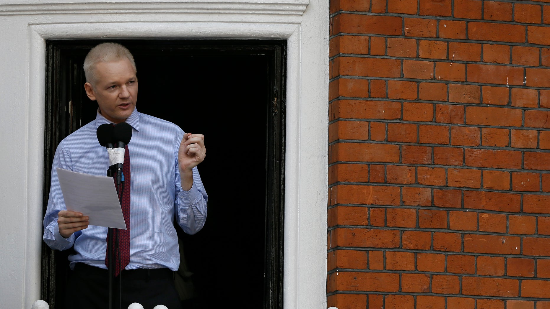 """Aug. 19, 2012: Julian Assange, founder of WikiLeaks makes a statement from a balcony of the Equador Embassy in London.  Assange called on United States President Barack Obama to end a """"witch hunt"""" against the secret-spilling WikiLeaks organization."""