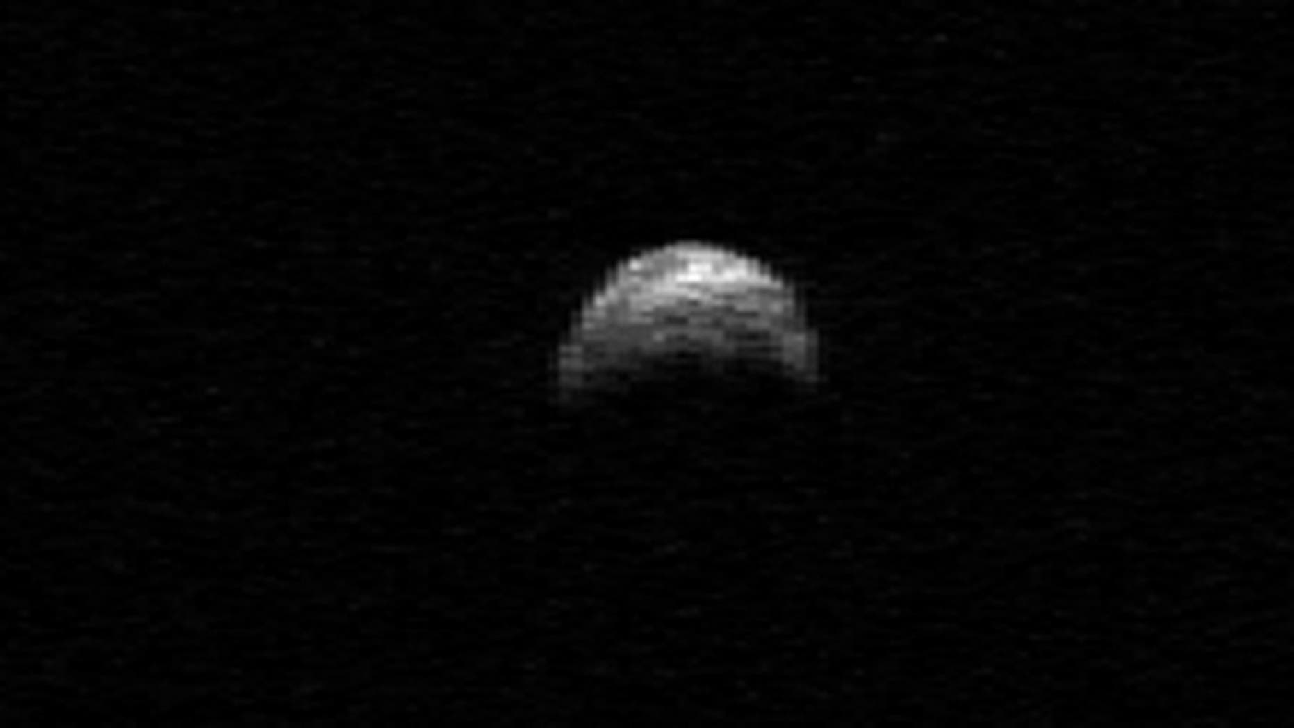 In April 2010, this radar image of the near-Earth asteroid 2005 YU55 was taken by the Arecibo radio telescope in Puerto Rico. On Nov. 8, 2011, this large space rock zips by Earth again and will be surveyed by radar, visual and infrared equipment.