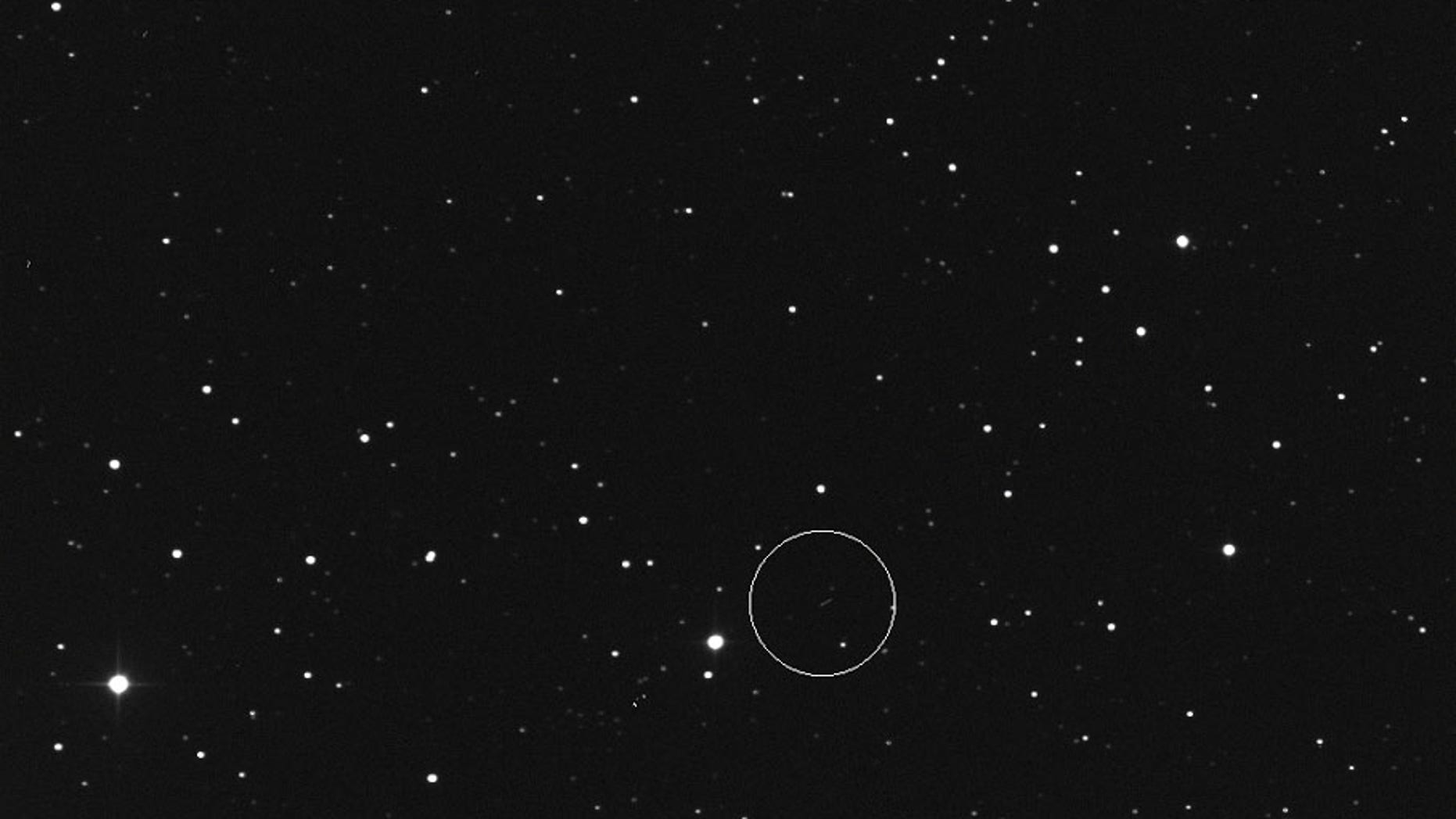 The asteroid 2017 BX is seen in this image (in circle) ahead of its close Earth flyby on Jan. 24, 2017. The asteroid passed by at a distance of 162,252 miles - about 30 percent closer than distance between the Earth and moon. (Slooh.com)
