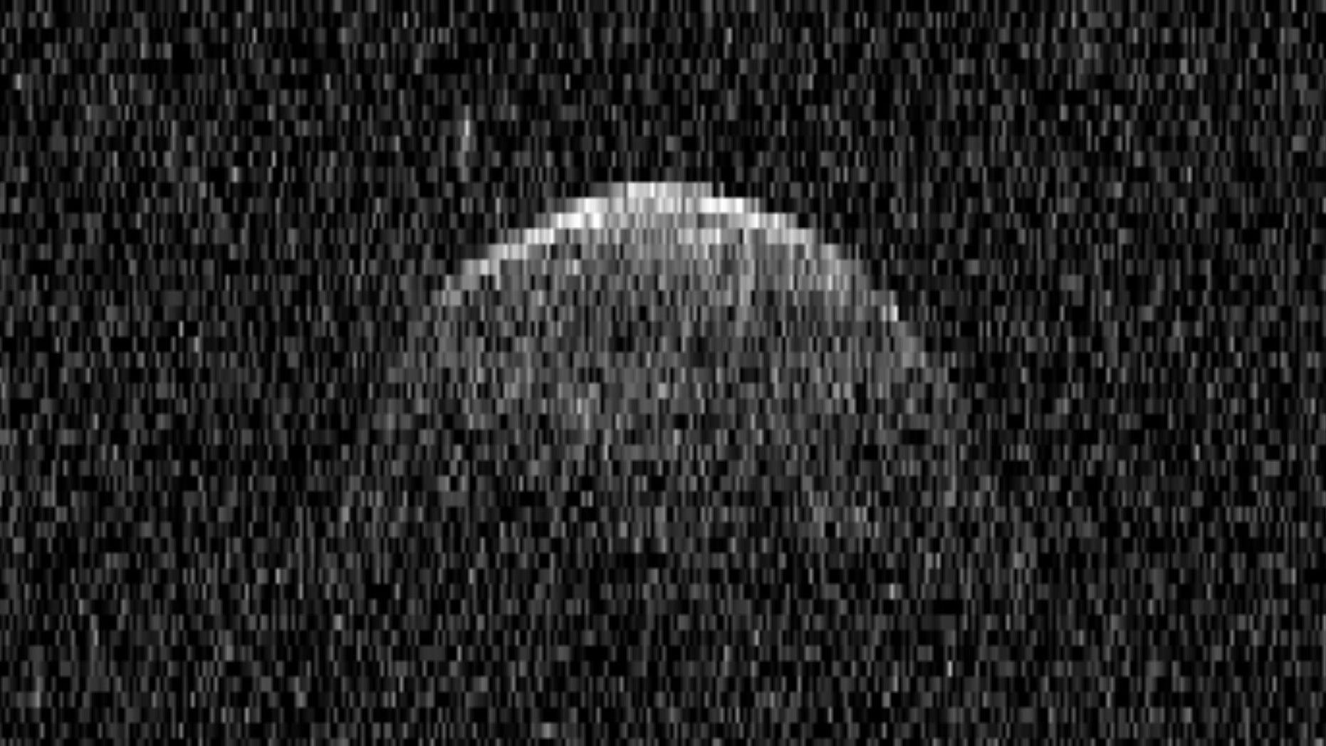 Radar image of asteroid Florence and one of its moons (small bright smudge above the main space rock) obtained on Sep. 1, 2017 using the 70-m antenna at NASA's Goldstone Deep Space Communications complex.