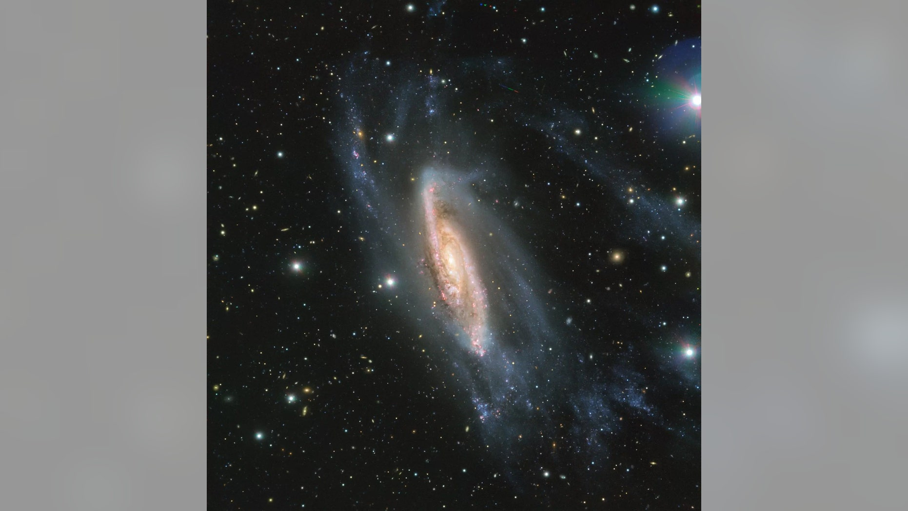 The European Southern Observatory's (ESO) Very Large Telescope in Chile captured this view of the spiral galaxy NGC 3981 in May 2018. The image was taken using the ESO's FORS2 instrument, as part of the Cosmic Gems program, which photographs the southern skies when conditions aren't good for scientific observations. An asteroid's trail can also be seen near the top, slightly right of center. Credit: ESO