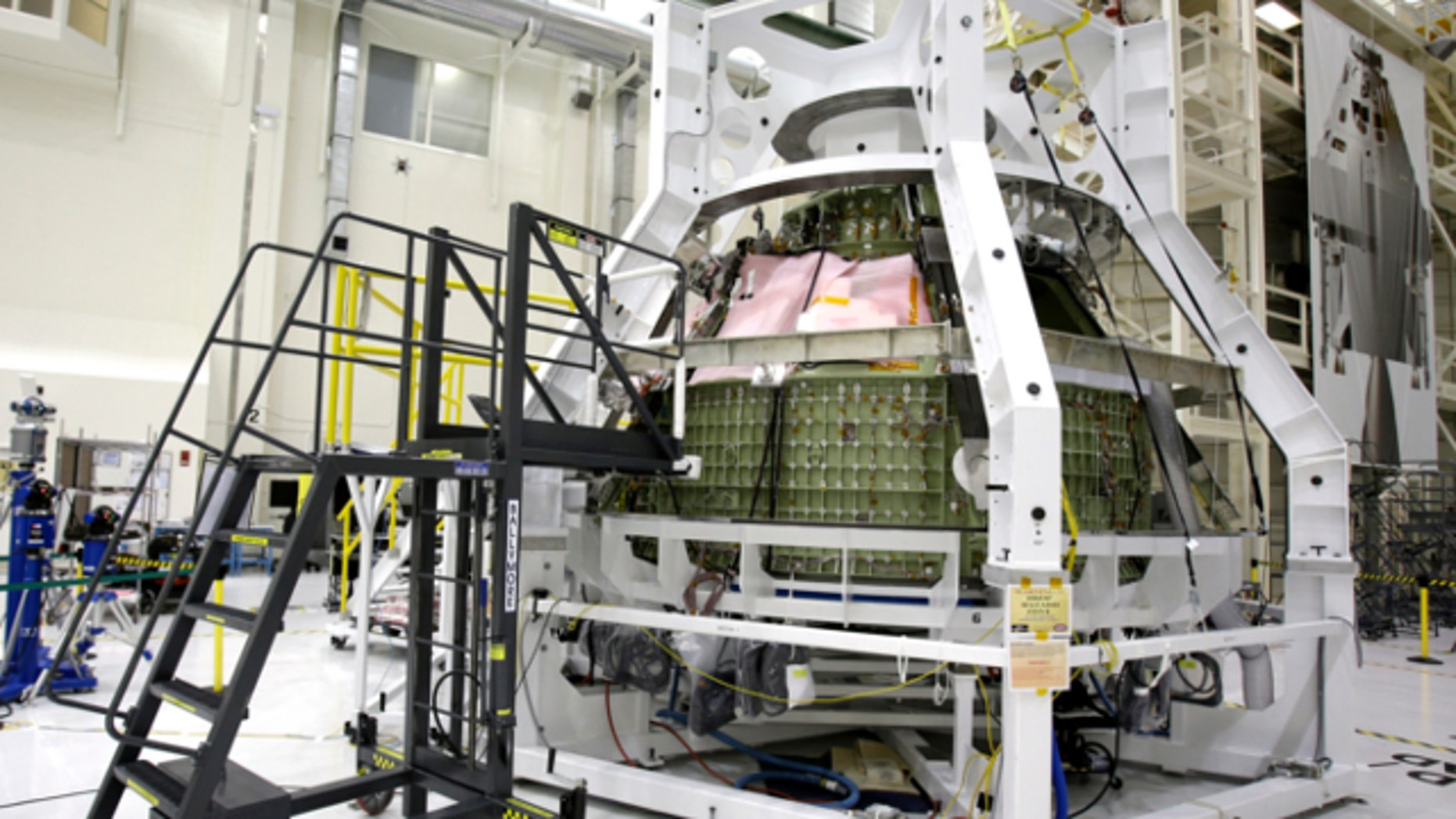 Jan. 13, 2013: The Orion Exploration Flight Test 1crew module is seen in the Operations and Checkout building during a media tour at the Kennedy Space Center in Cape Canaveral, Fla.