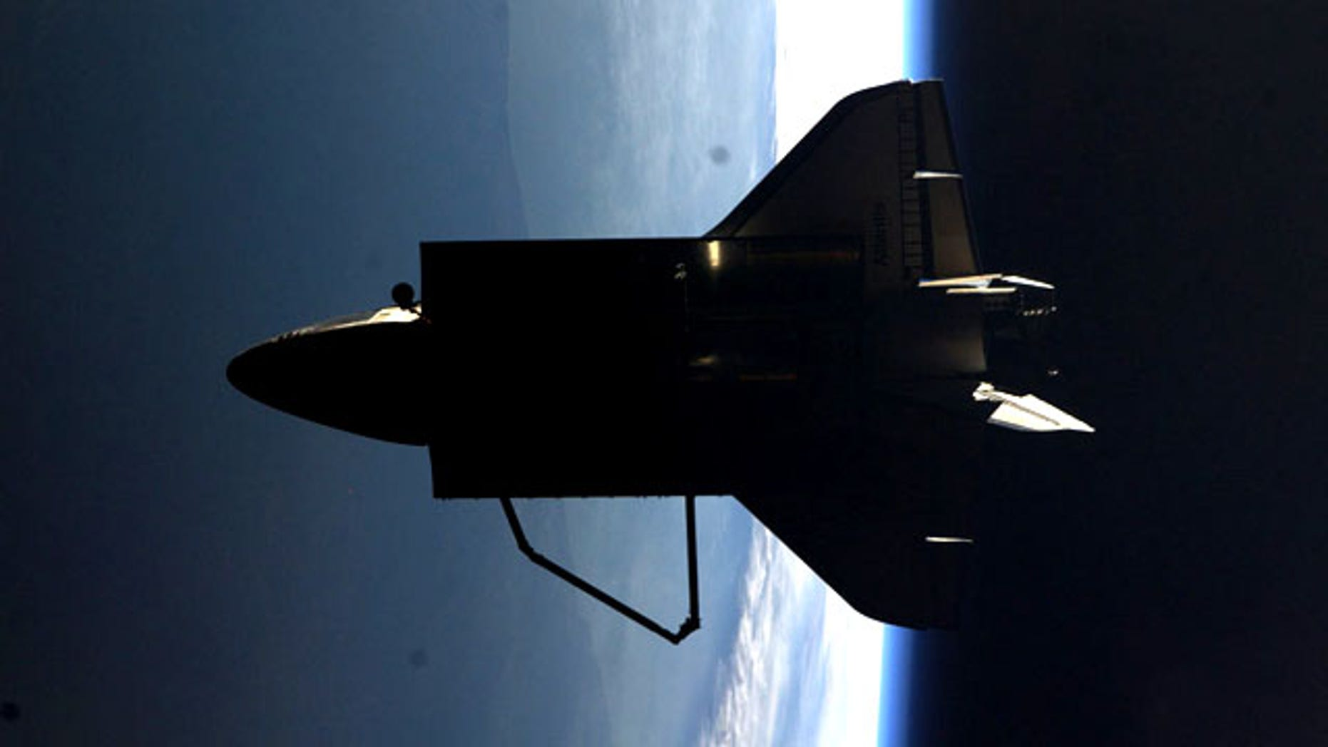 """Astronaut Ron Garan tweeted this picture from the International Space Station: """"The view #FromSpace of Shuttle #Atlantis flyaround of #ISS today (7/19/11) from Sergei's bedroom window."""""""
