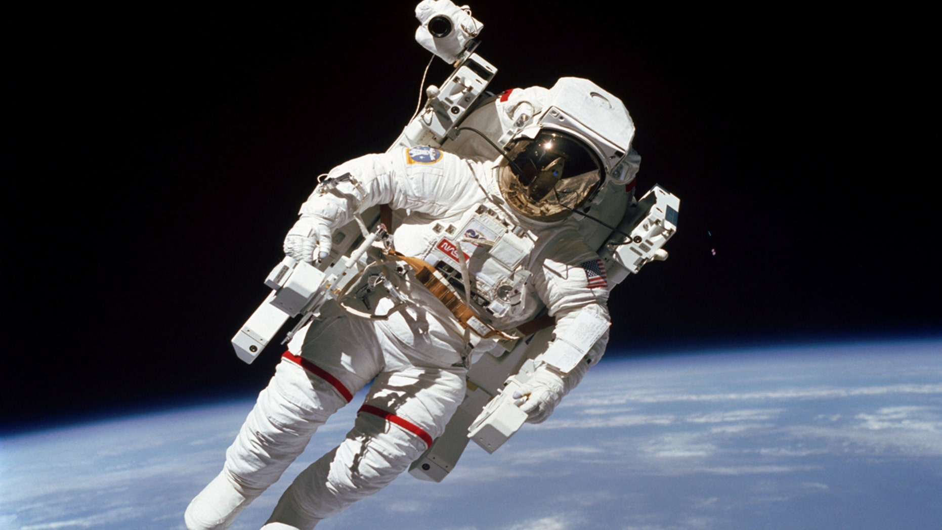 File Feb. 7, 1984: Astronaut Bruce McCandless participates in a spacewalk a few meters away from the cabin of the Earth-orbiting space shuttle Challenger, using a nitrogen-propelled Manned Maneuvering Unit.