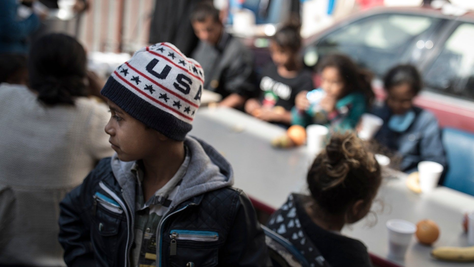 Migrant children have their breakfast at a shelter in Tijuana, Mexico on Saturday.