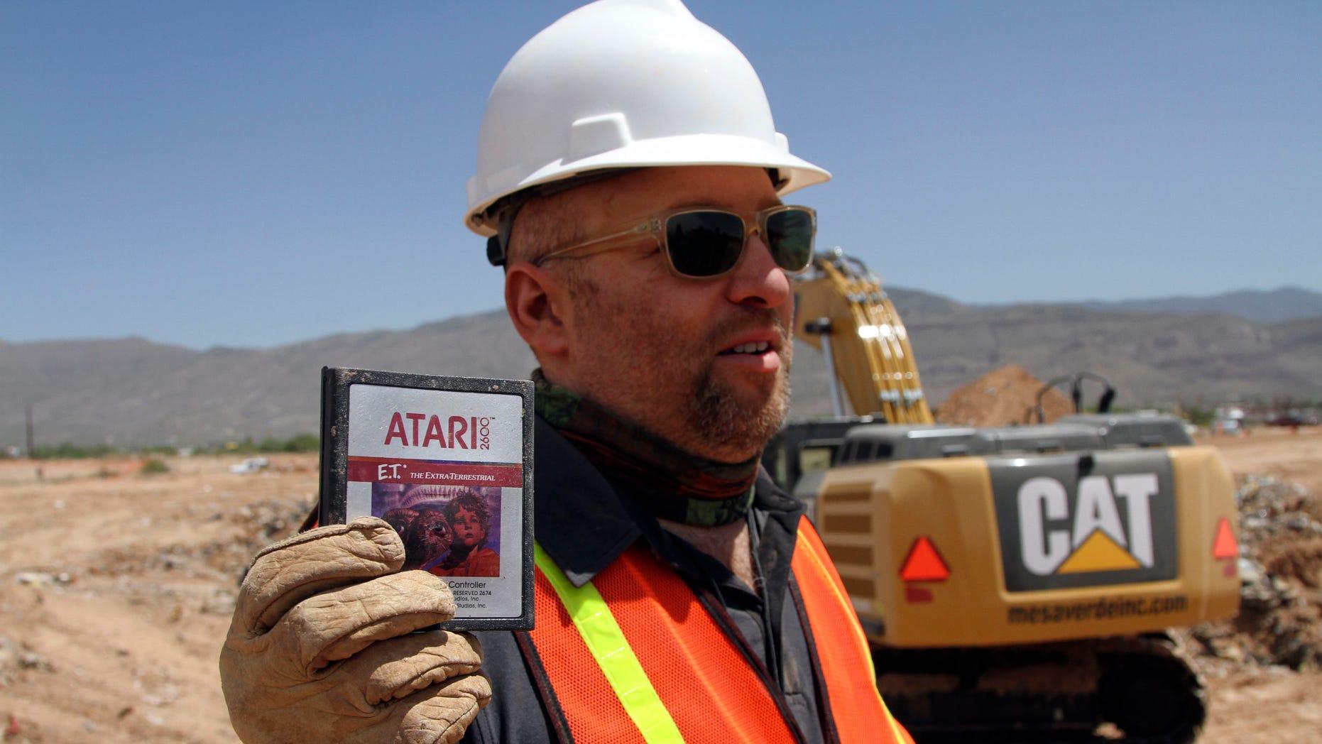 April 26, 2014: Film director Zak Penn shows a box of a decades-old Atari 'E.T. the Extra-Terrestrial' game found in a dumpsite in Alamogordo, N.M.