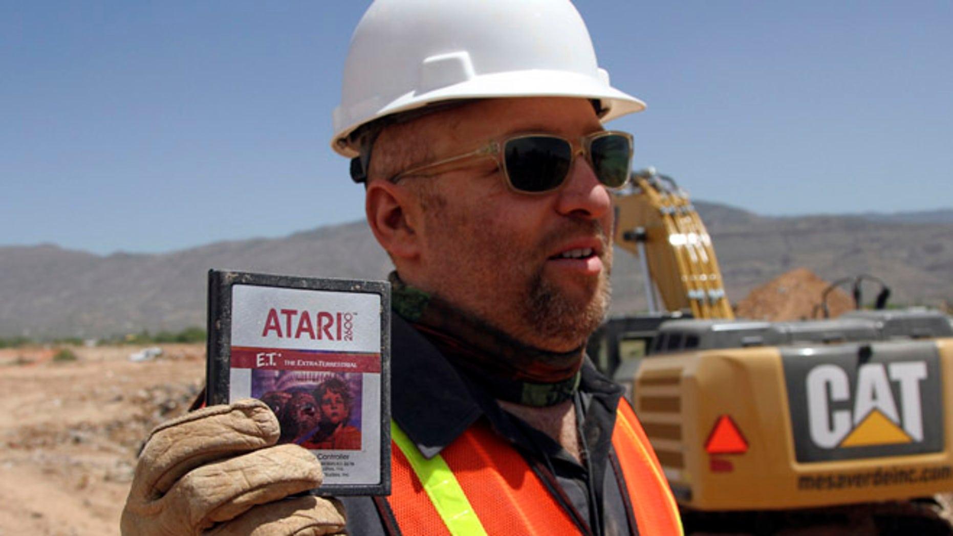 Apr. 26, 2014: Film Director Zak Penn shows a box of a decades-old Atari 'E.T. the Extra-Terrestrial' game found in a dumpsite in Alamogordo, N.M.