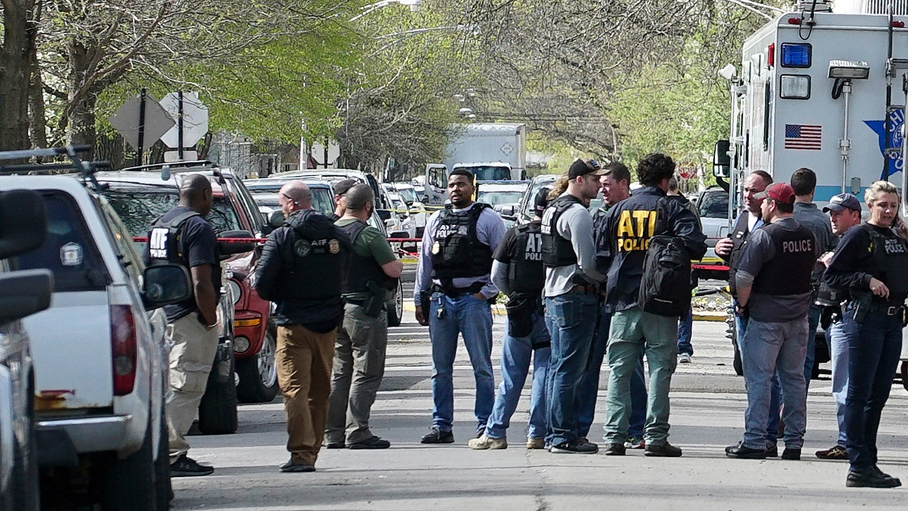 Police from various agencies investigate the scene where a Bureau of Alcohol, Tobacco, Firearms and Explosives agent was shot, Friday, May 4, 2018, in Chicago.