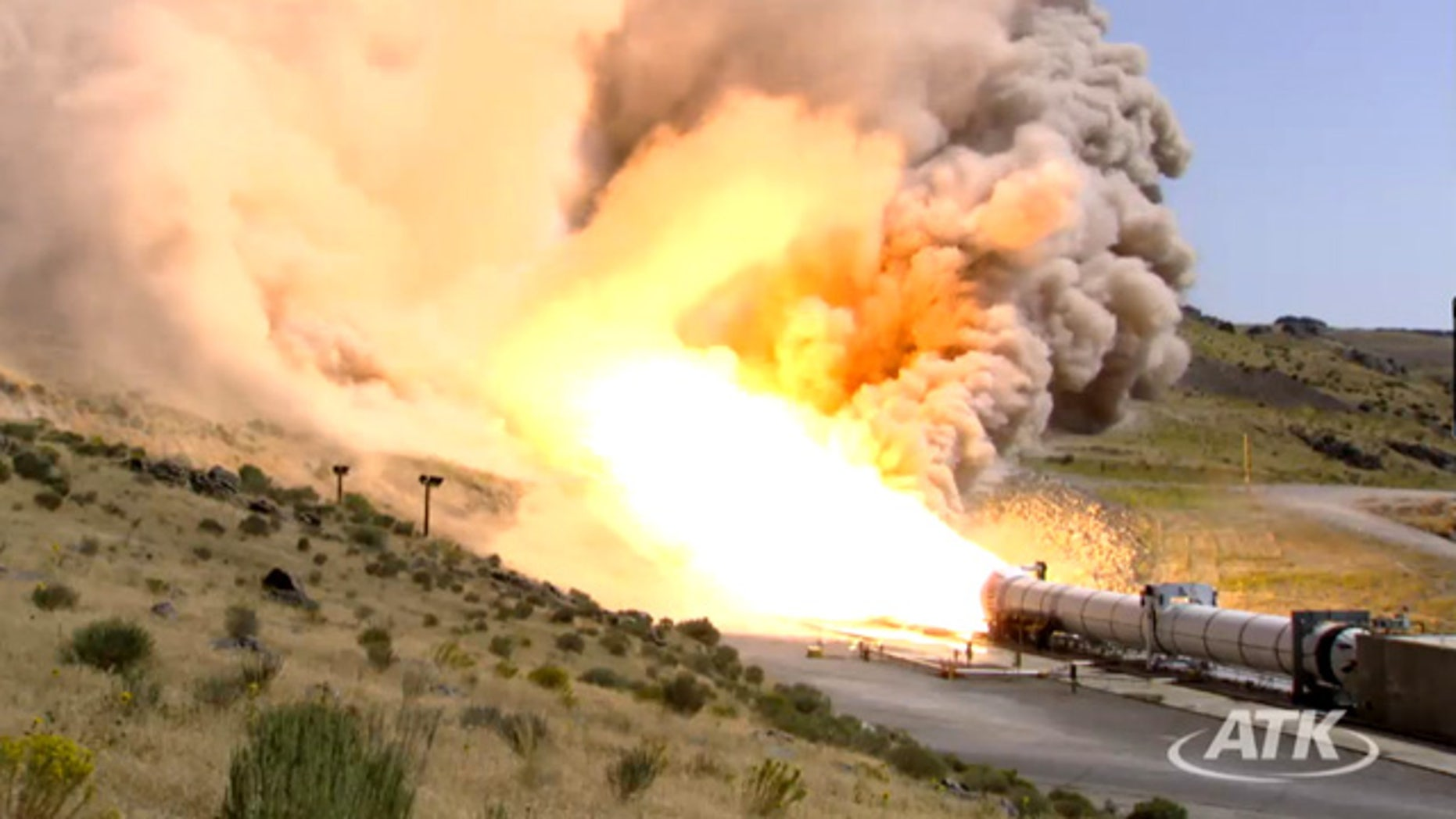 This still from an ATK webcast shows a side view of the five-segment solid rocket booster DM3 during a Sept. 8, 2011 static test firing at the company's motor proving grounds near Promontory, Utah.