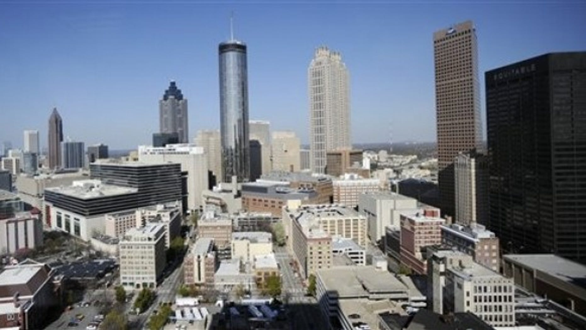 The Atlanta skyline is shown Thursday, March 17, 2011. According to census data released Thursday Atlanta's population slowed over the last 10 years with the city adding only 1 percent as people fled to the suburbs seeking better schools, cheaper homes and safer neighborhoods. (AP Photo/Mike Stewart)