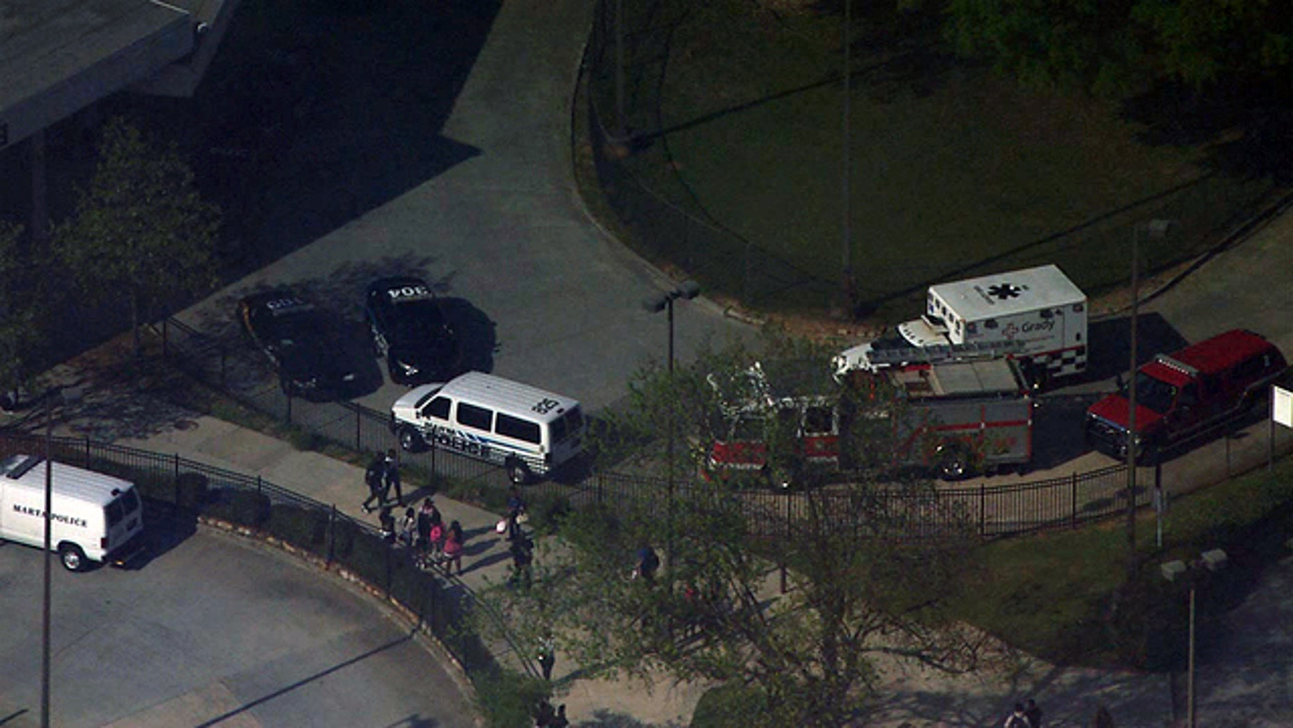 Emergency vehicles respond to the West Lake MARTA station after a shooting on board a train in Atlanta Thursday, April 13, 2017.