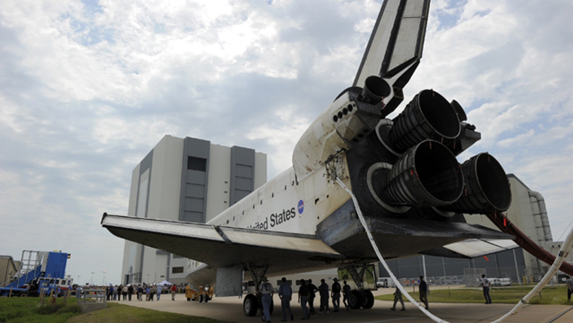 Space shuttle Atlantis is slowly towed from the Shuttle Landing Facility to an orbiter processing facility at NASA's Kennedy Space Center in Florida for the last time. Atlantis' final return from space at 5:57 a.m. EDT secured the space shuttle fleet's place in history and brought a close to the America's Space Shuttle Program.