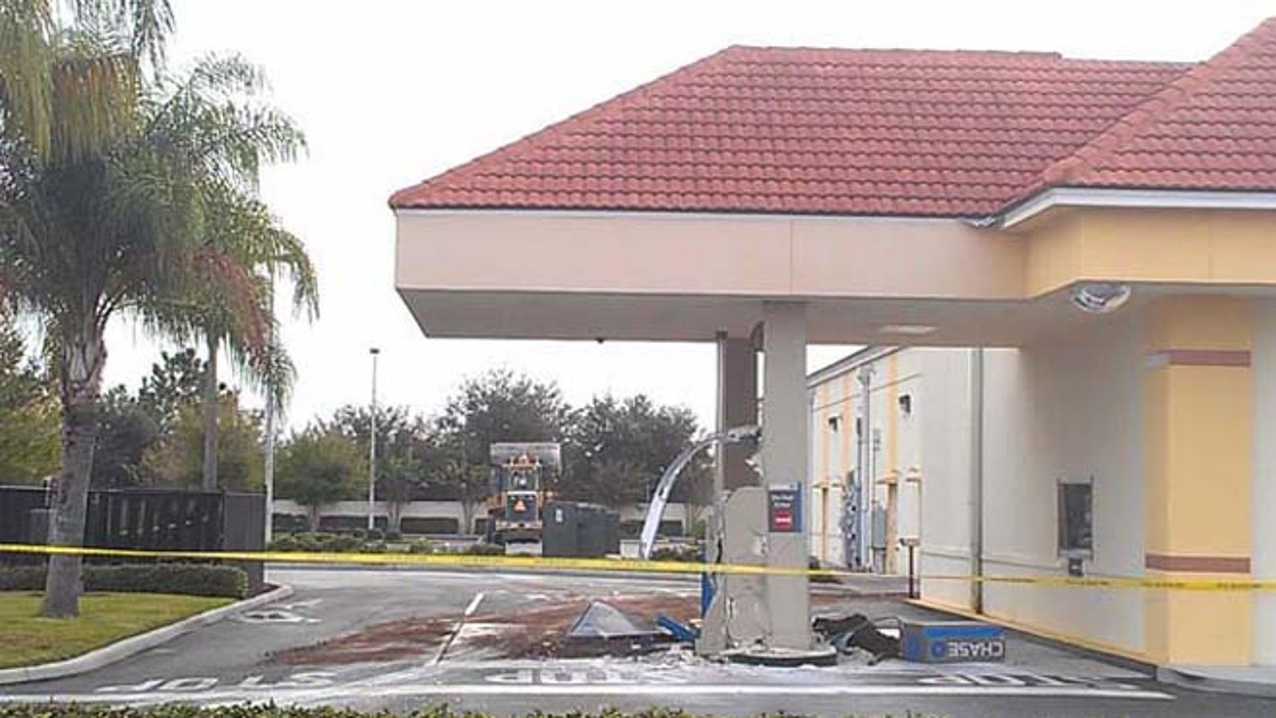 Nov. 21, 2013: Orlando police believe suspects used construction equipment to rip an ATM out of the ground at a Chase Bank drive-thru.