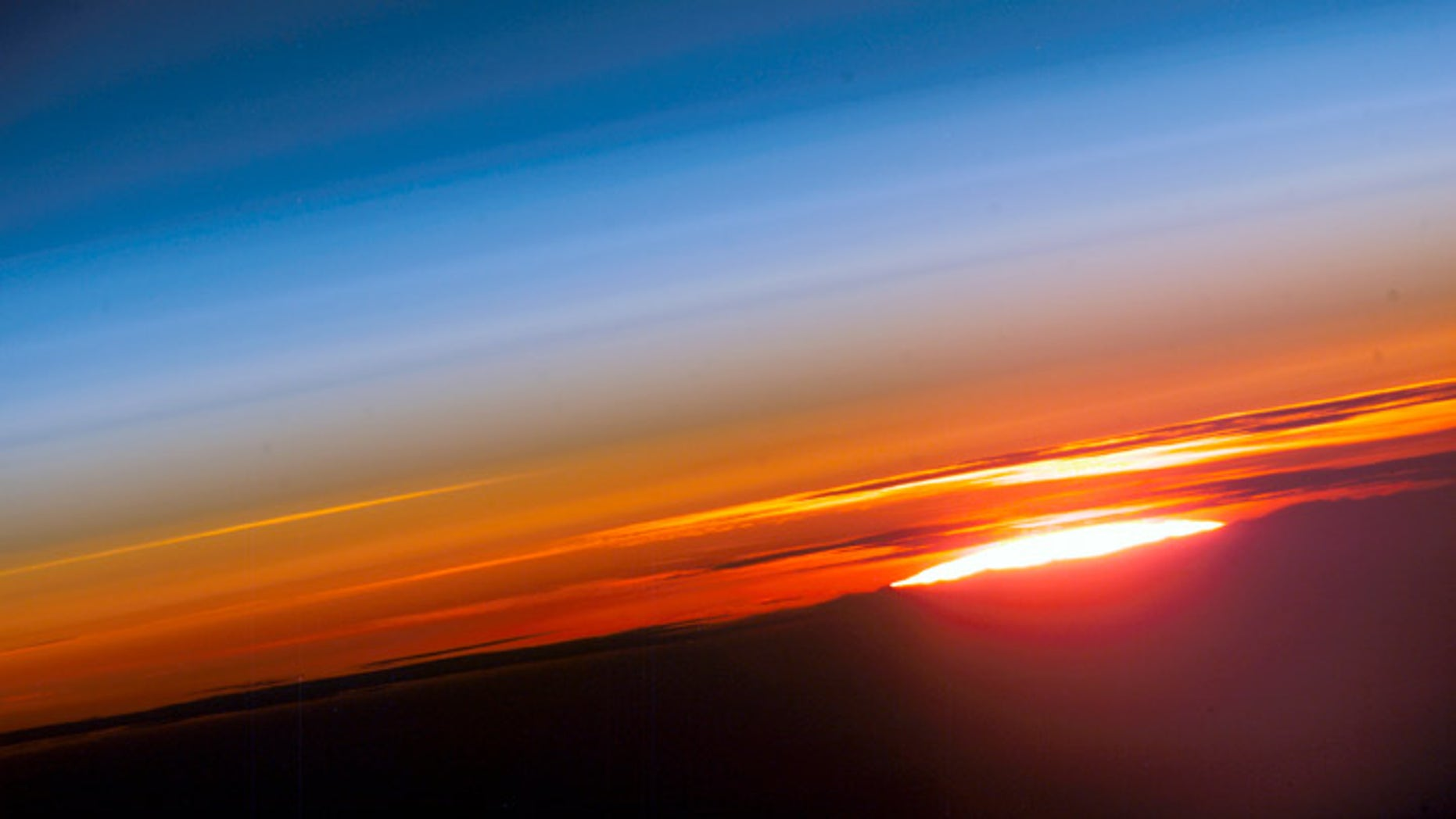 The sun rises over planet Earth in this photo an astronaut captured from the International Space Station.