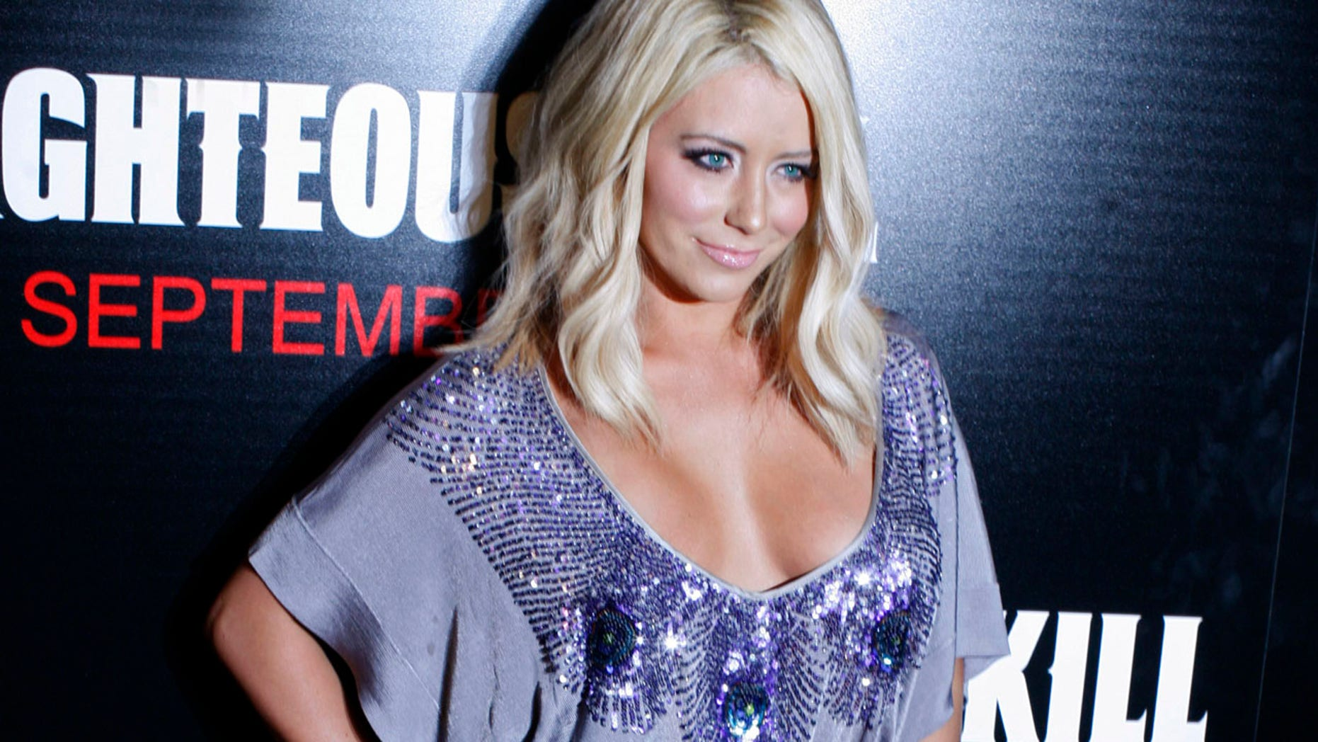 "Actress Aubrey O'Day arrives for the premiere of the film ""Righteous Kill"" in New York September 10, 2008. REUTERS/Keith Bedford (UNITED STATES) - RTX8NFI"