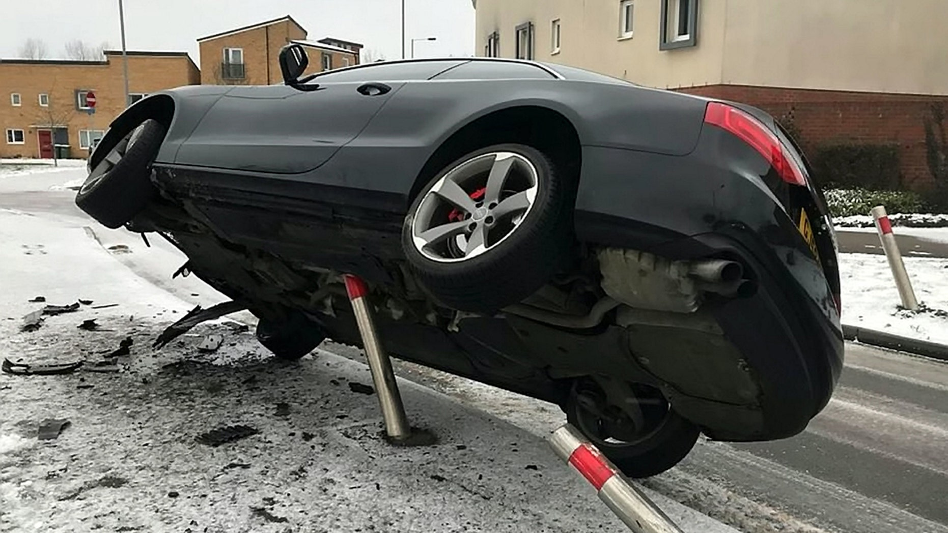 """This is the unbelievable moment in which a black Audi is frozen mid air after veering off the road and colliding with a metal post on a frost covered pavement. See Masons story MNAUDI; The picture shows a freeze-frame moment which looks like it is from an action movie with the car caught in the air at a seemingly impossible angle. Beds Cambs Herts Road Policing Unit said the suspected driver was standing by his car when they arrived and blew a breath test of almost double the drink drive limit. BCH Road Policing said on Twitter: """"2nd Job this morning in #Peterborough, suspected driver stood next to his car blew 72ugl roadside, driver on way to #custody for evidential readings."""" No-one was injured in the crash. Cambs police have been contacted for comment."""