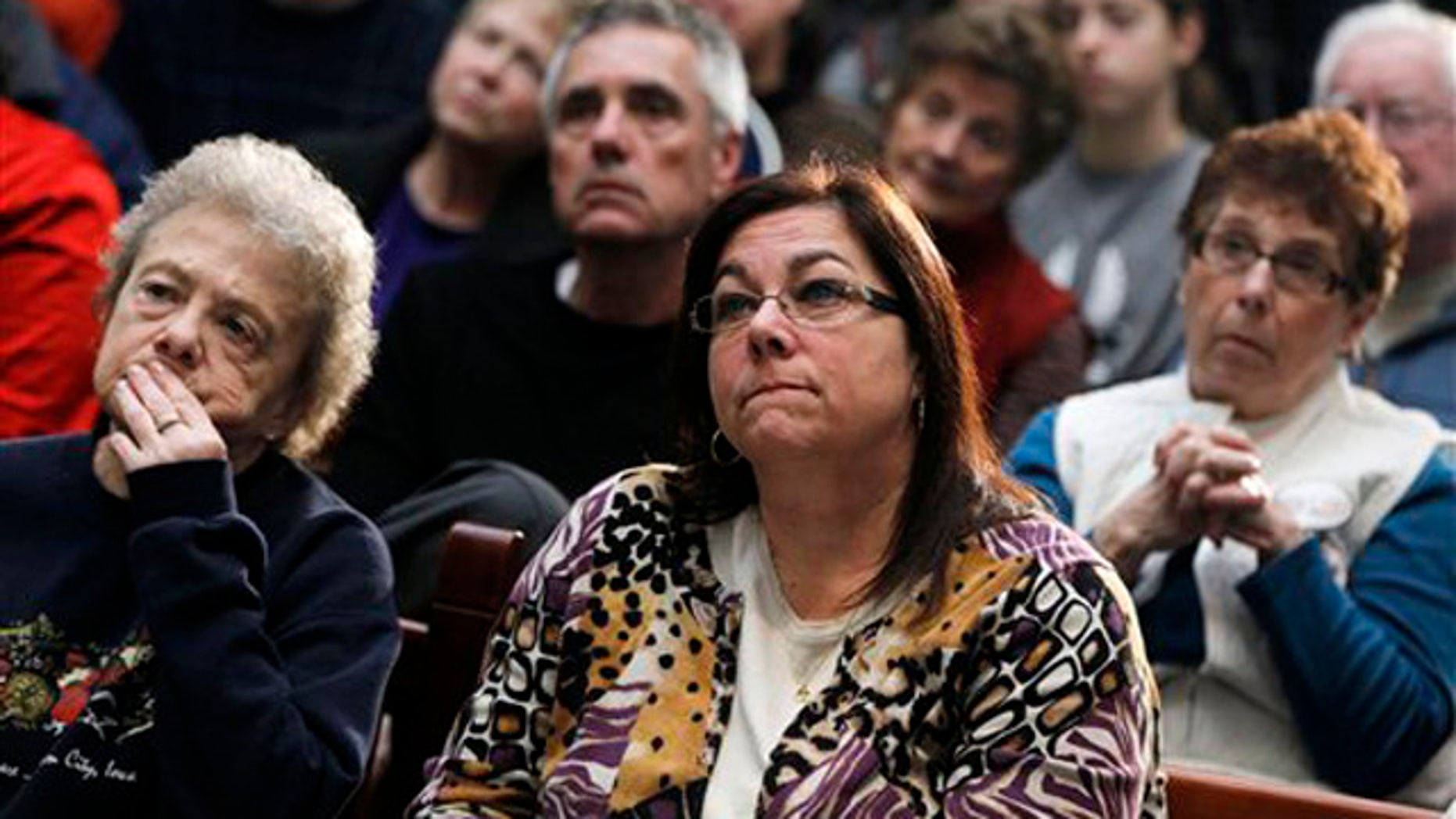 Dec. 28, 2011: Audience members listen as former House Speaker Newt Gingrich speaks during a campaign stop at the Southbridge Mall in Mason City, Iowa.