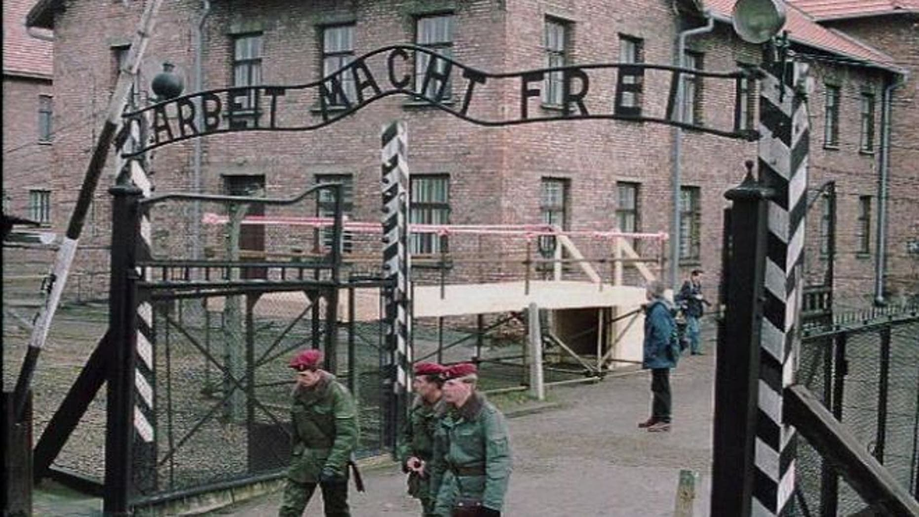 "FILE: This image shows the of the gate at Auschwitz, former Nazi concentration camp, with slogan ""Work Makes You Free."" (AP)"