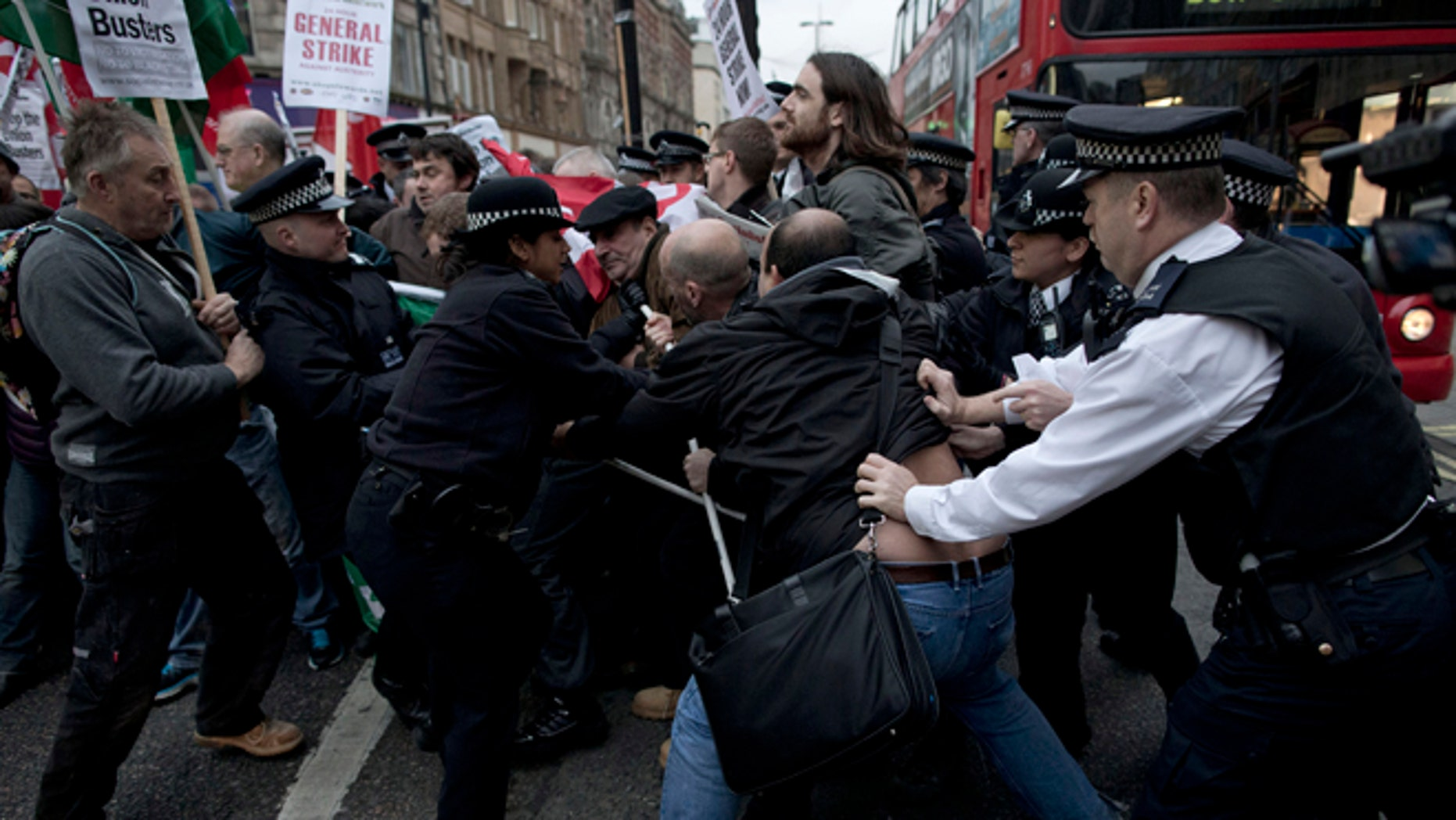 Nov. 14, 2012: Police officers try to push protesters back onto the pavement after they blocked traffic on Oxford Street, London, whilst taking part in a picket and demonstration they said was over dismissals of 28 workers employed by contractors on the Crossrail transport project, for being trade union members.