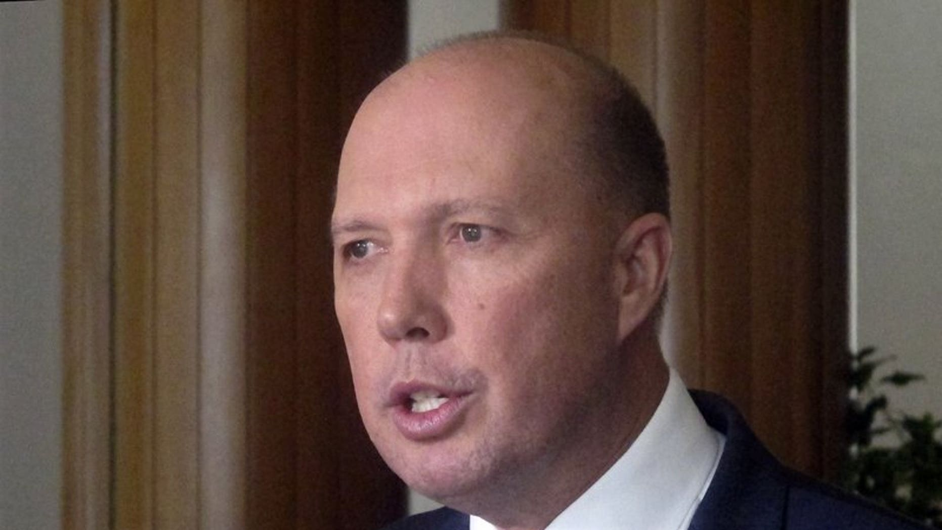 Australia's Immigration and Border Protection Minister Peter Dutton speaks to reporters at Parliament House in Canberra, Australia (AP)