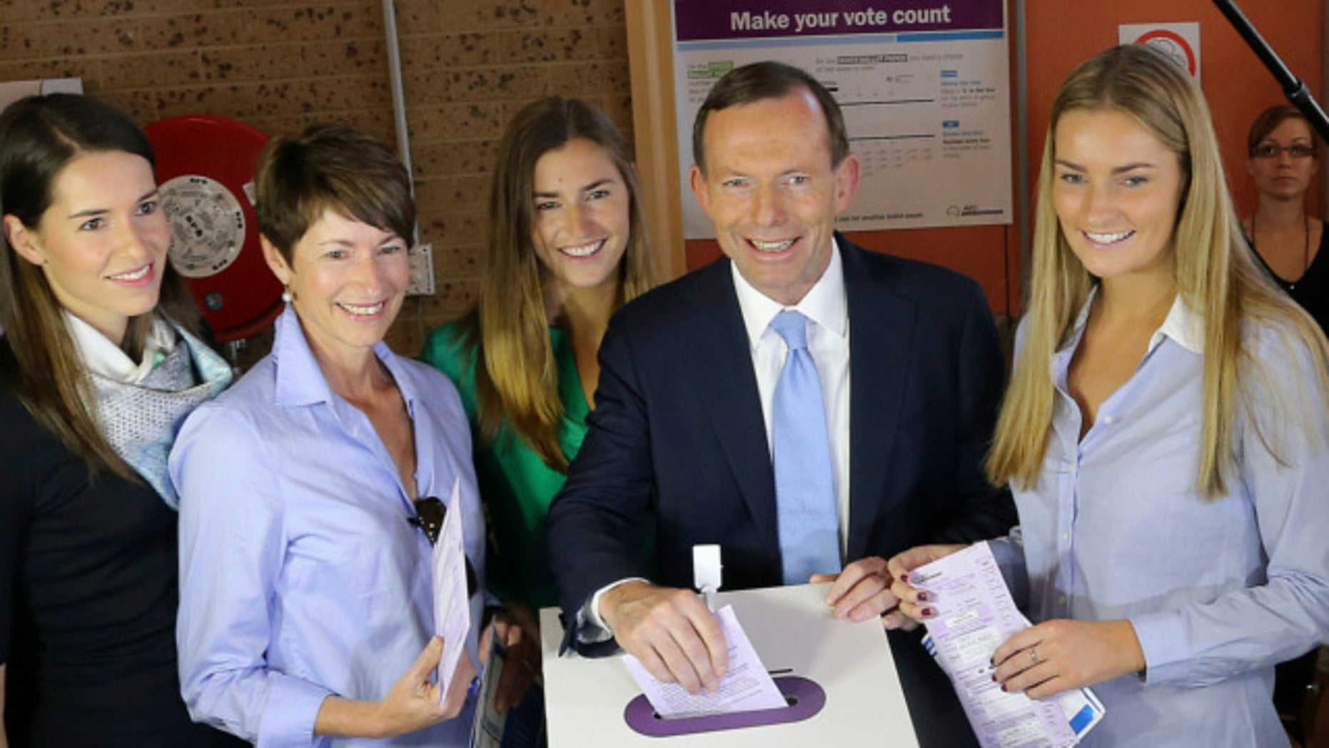 Sept. 7, 2013: Australia's opposition leader Tony Abbott, second right, and his family, from right, Bridget, Frances, wife Margaret and Louise cast their ballots at Freshwater Surf Club in Sydney, Australia.