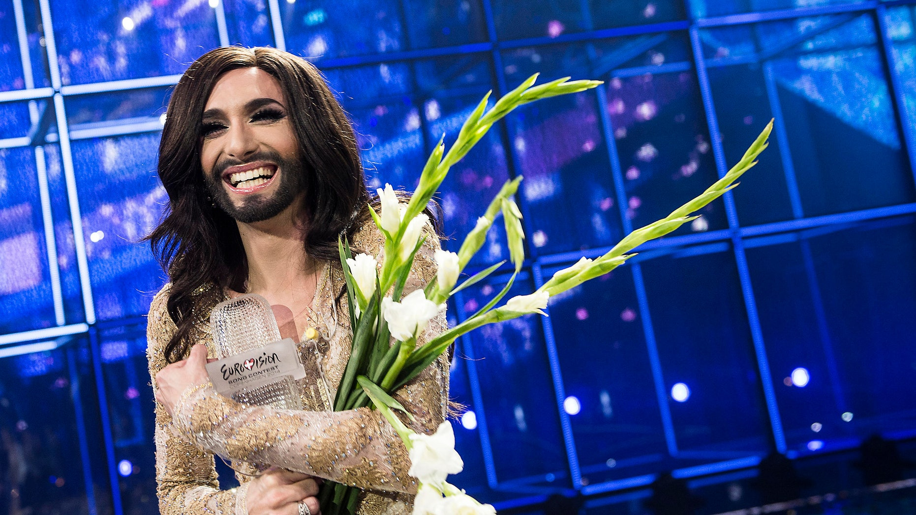 May 10, 2014. Conchita Wurst representing Austria poses with the trophy after winning the 59th annual Eurovision Song Contest (ESC) at the B&W Hallerne in Copenhagen.