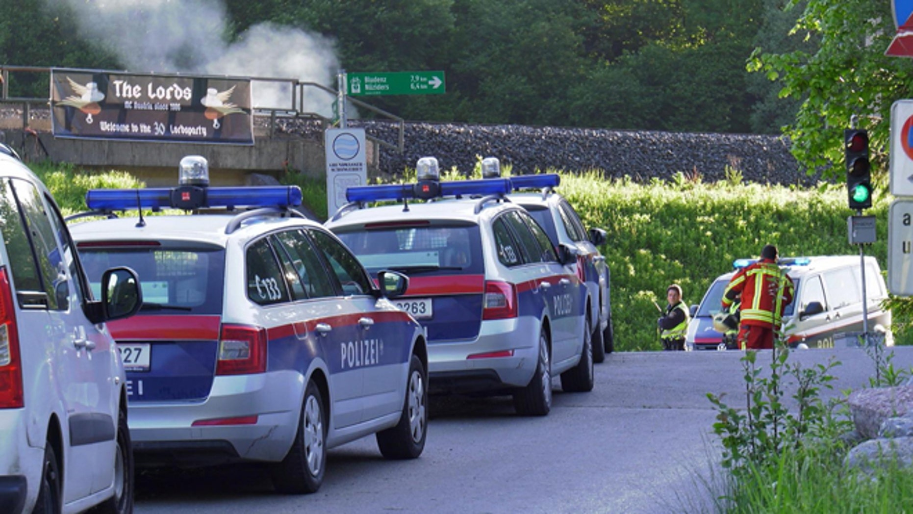 This image made from TV shows police attending the scene of a shooting near Nenzing, Austria, Sunday May 22, 2016. (AP)