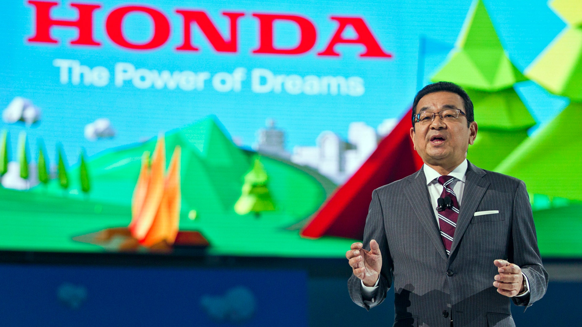 Takahiro Hachigo, President and CEO of Honda, speaks at the North American International Auto Show, Monday, Jan. 9, 2017, in Detroit.
