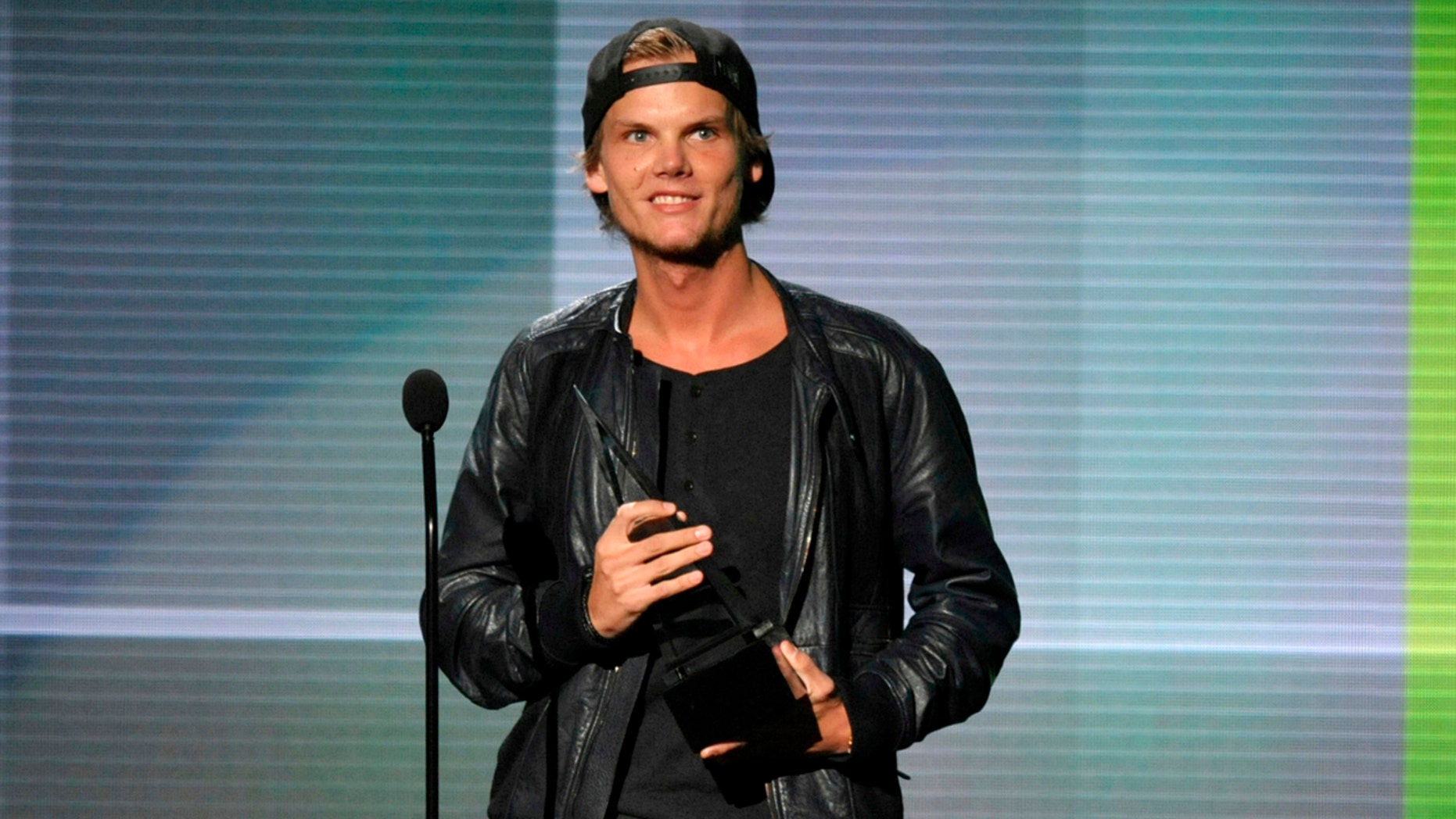 """In this Nov. 24, 2013 file photo, Avicii accepts the award for favorite artist - electronic dance music at the American Music Awards in Los Angeles. Avicii's family released a statement Monday, April 23, 2018, saying they """"would like to thank you for the support and the loving words about our son and brother."""" They say they are grateful for his fans around the world who loved his music. Swedish-born Avicii, whose name is Tim Bergling, was found dead, April 20, in Muscat, Oman."""