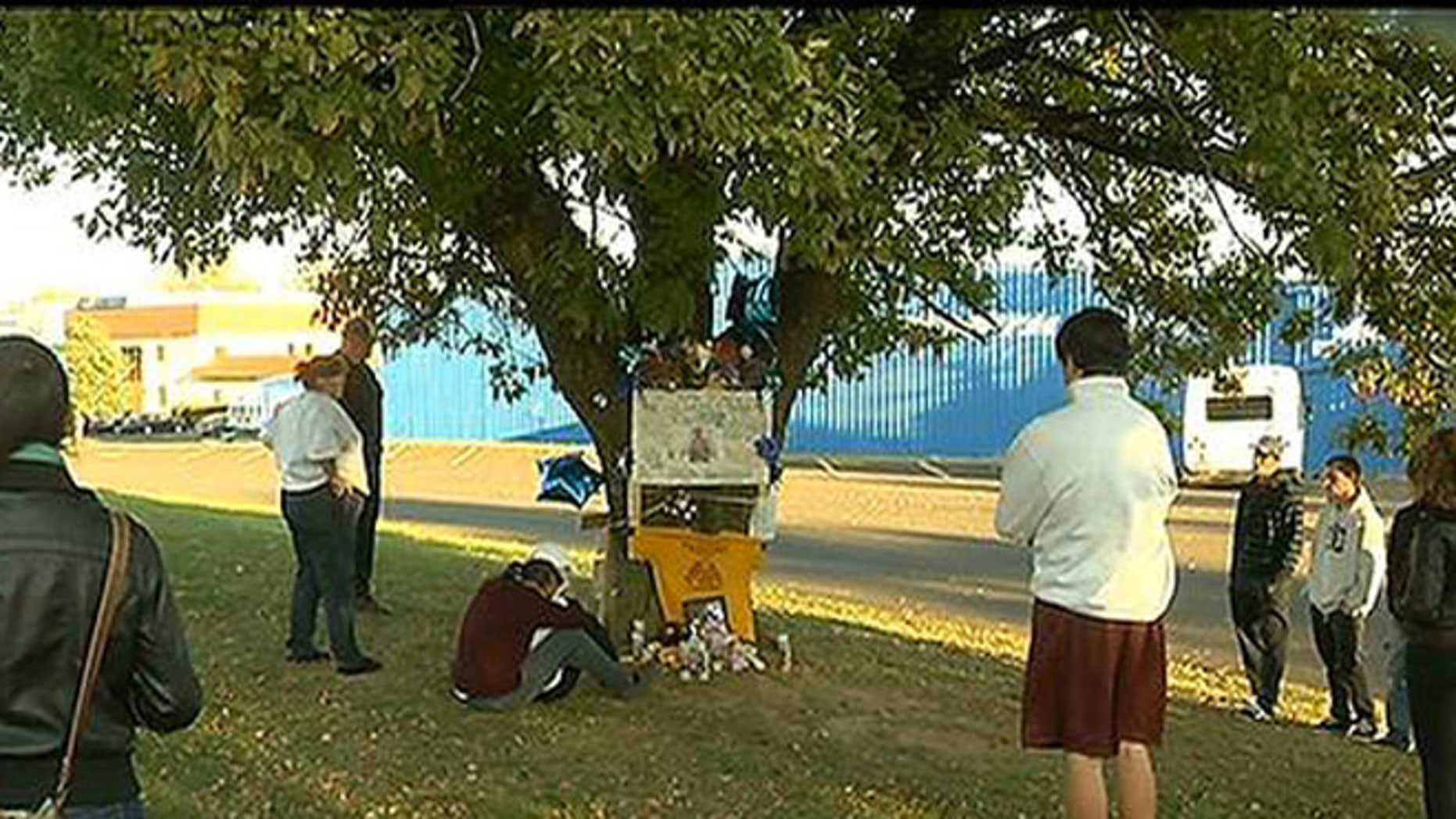 Oct. 27, 2013: Visitors gather around a memorial for Christopher Avlevo, who was killed in Philadelphia Saturday while trying to steer a pickup truck to safety after his stepfather blacked out behind the wheel.