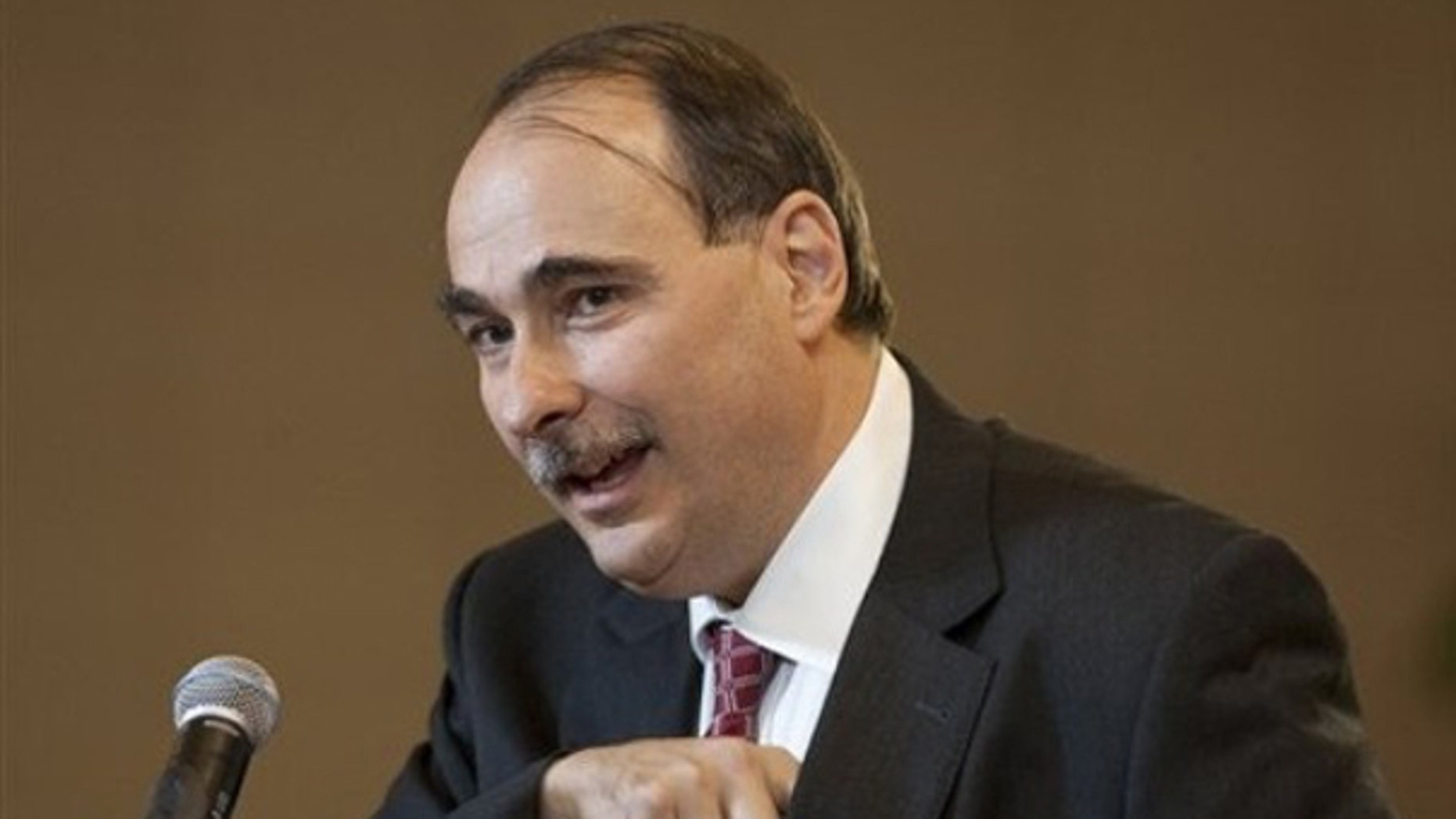 David Axelrod reaches for his glasses as he speaks at the University of Nebraska-Lincoln, in Omaha, Neb., Oct. 9. (AP Photo)