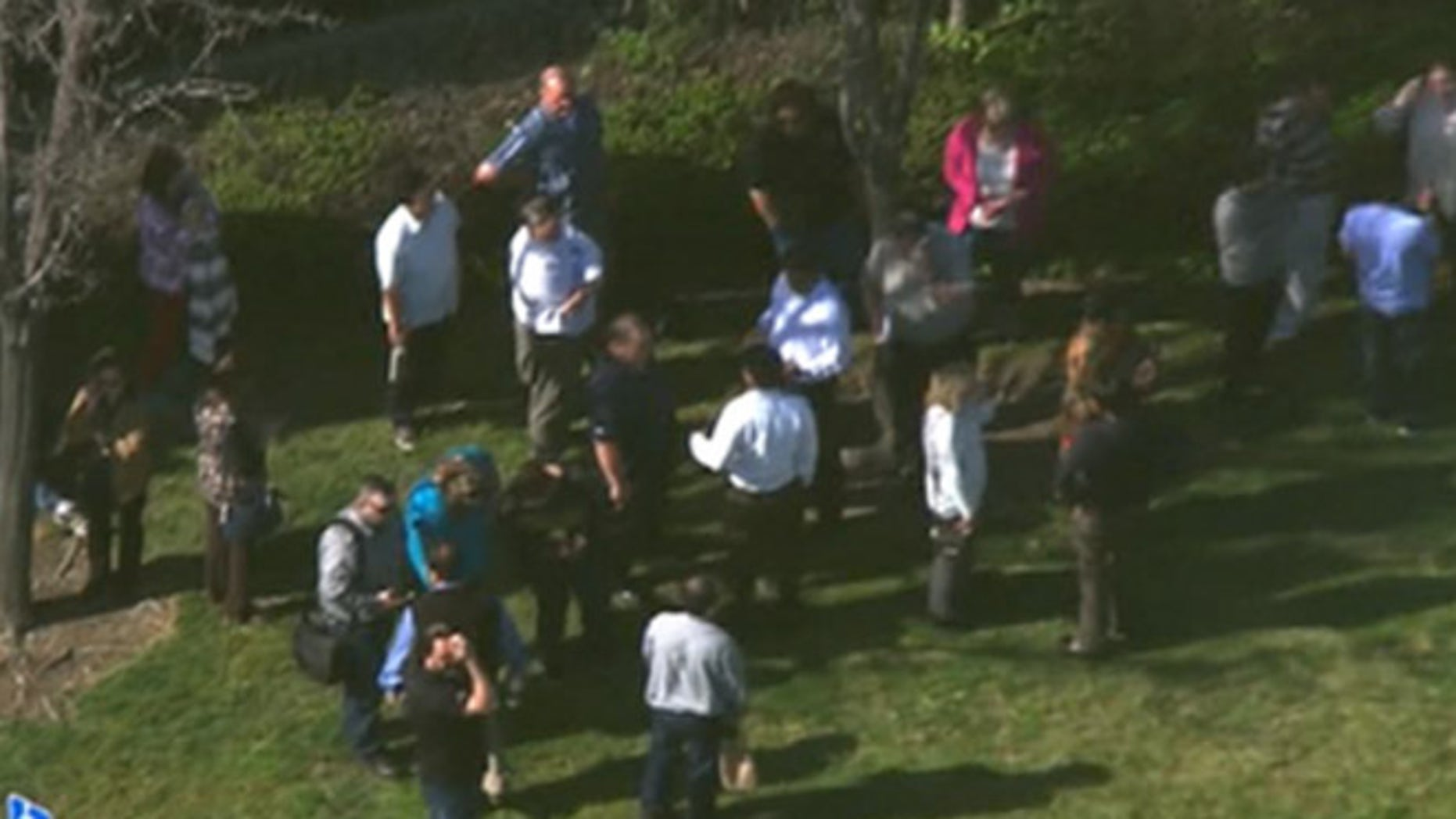 Emergency crews respond to reports of a suspicious package outside a federal building in Alameda, Calif.