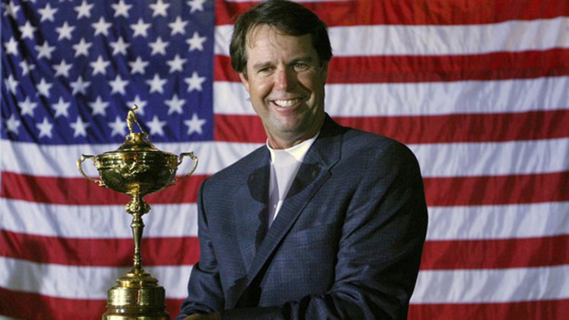 U.S. team captain Paul Azinger holds the Ryder Cup after defeating the European team to win the 37th Ryder Cup Championship at the Valhalla Golf Club in Louisville, Ky., in this Sept. 21, 2008 file photo.