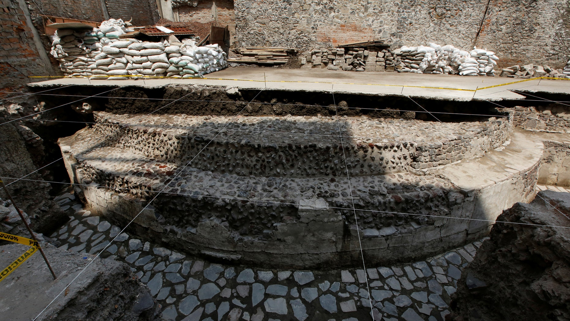 A new Aztec discovery of the remains of the main temple of the wind god Ehecatl, a major deity, is seen during a tour of the area, located just off the Zocalo plaza in the heart of downtown Mexico City, Mexico June 7, 2017. (REUTERS/Henry Romero)