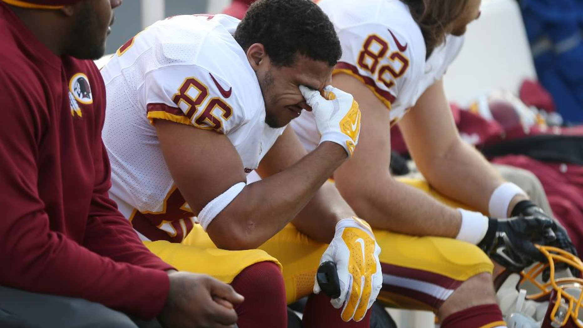 Washington Redskins tight end Jordan Reed reacts on the sidelines at the end of an NFL football game against the Minnesota Vikings, Sunday, Nov. 2, 2014, in Minneapolis. The Vikings won 29-26. (AP Photo/Jim Mone)