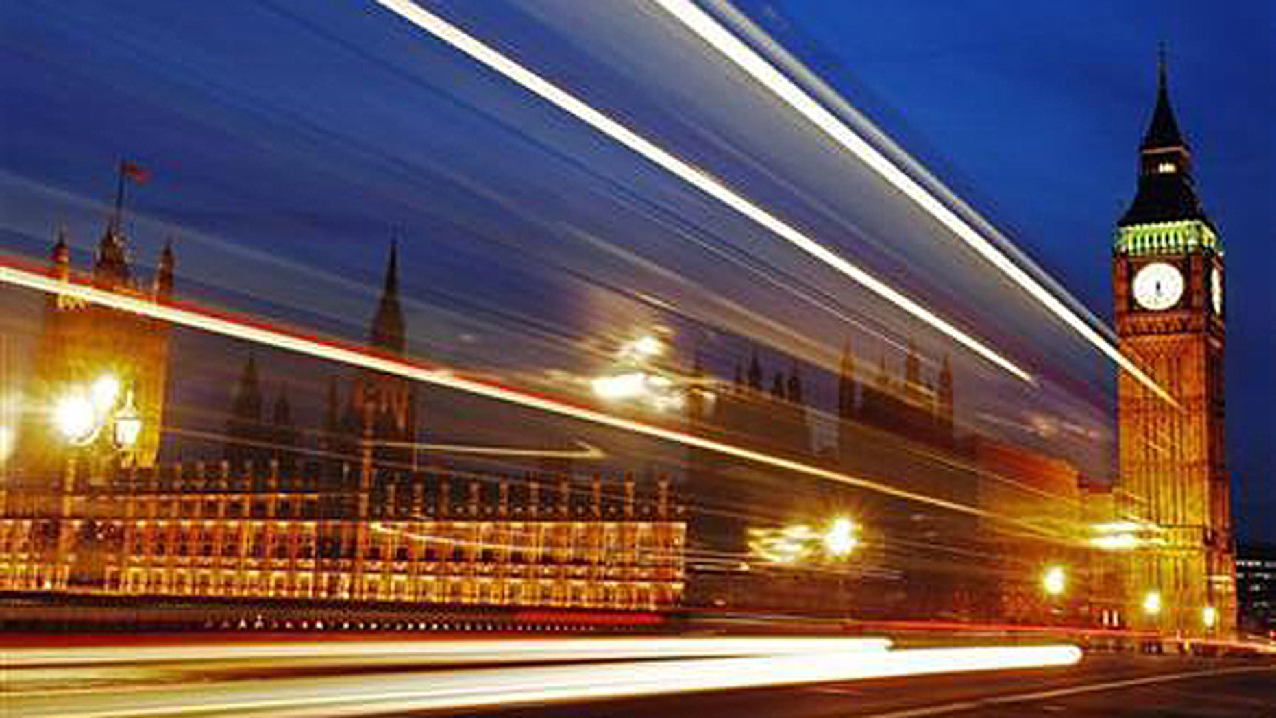 Light trails made by a passing bus illuminate the night sky in front of Britain's Houses of Parliament in London, February 4, 2010.