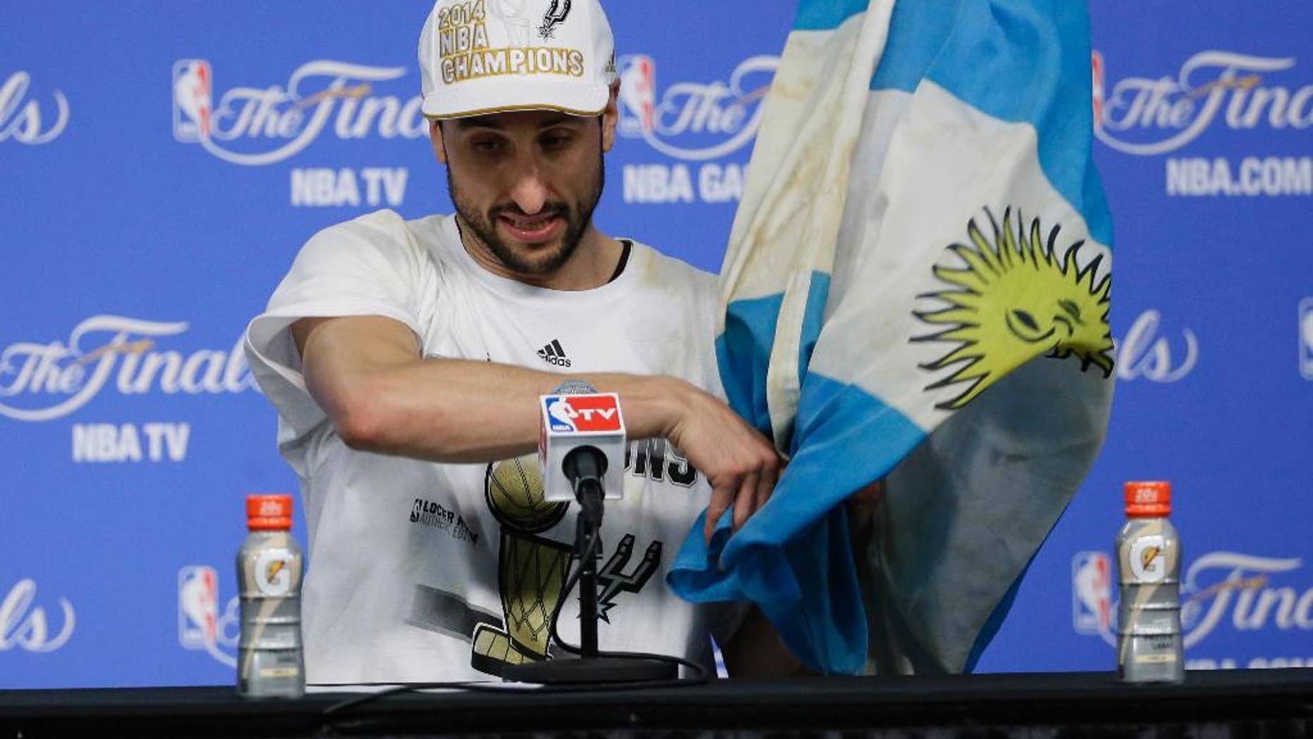 San Antonio Spurs guard Manu Ginobili arrives for a news conference after  Game 5 of the NBA basketball finals against the Miami Heat on Sunday, June 15, 2014, in San Antonio. (AP Photo/Tony Gutierrez)