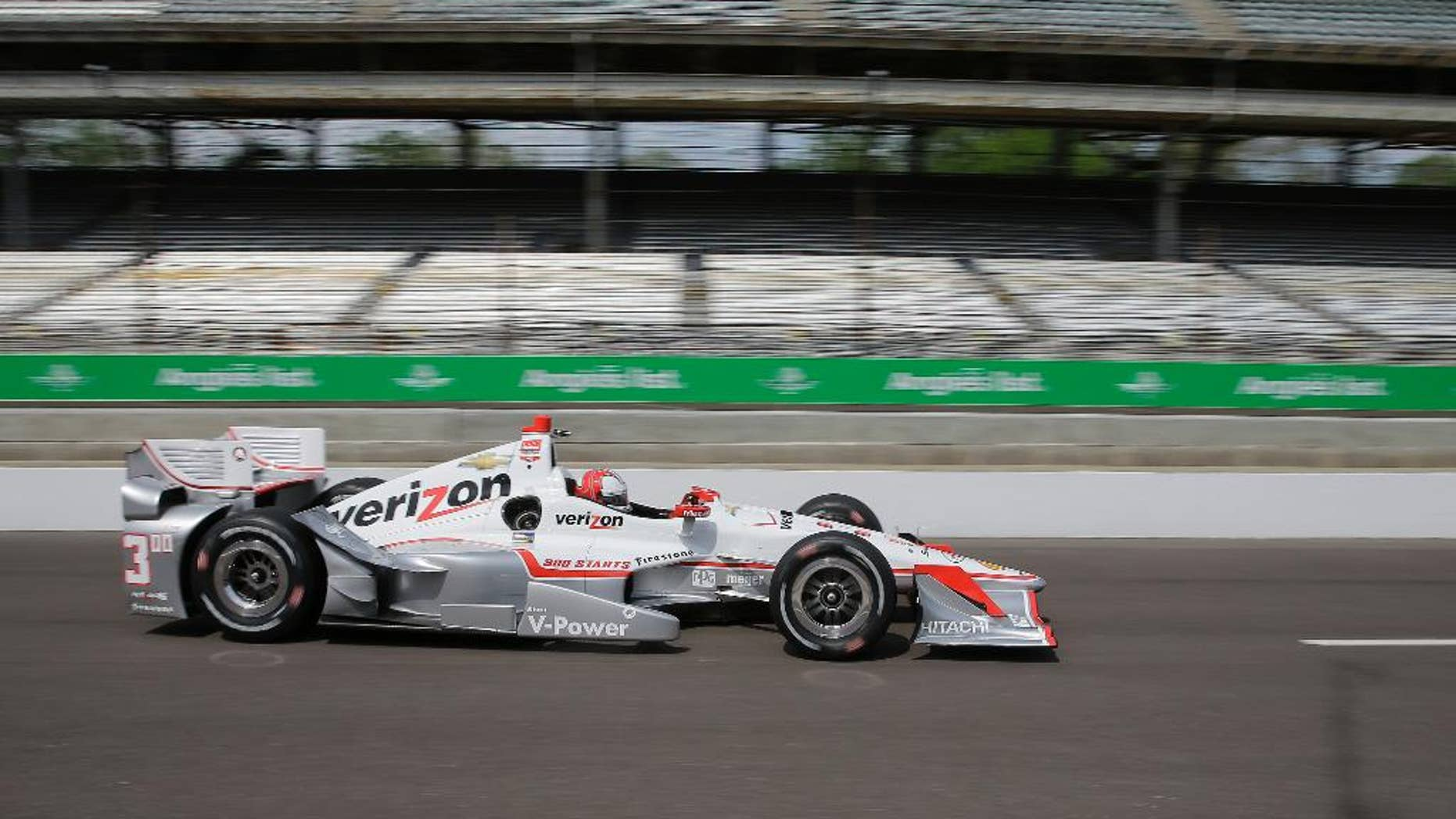 Helio Castroneves, of Brazil, drives down pit road during practice for the Grand Prix of Indianapolis auto race at the Indianapolis Motor Speedway in Indianapolis, Friday, May 8, 2015.  (AP Photo/Darron Cummings)