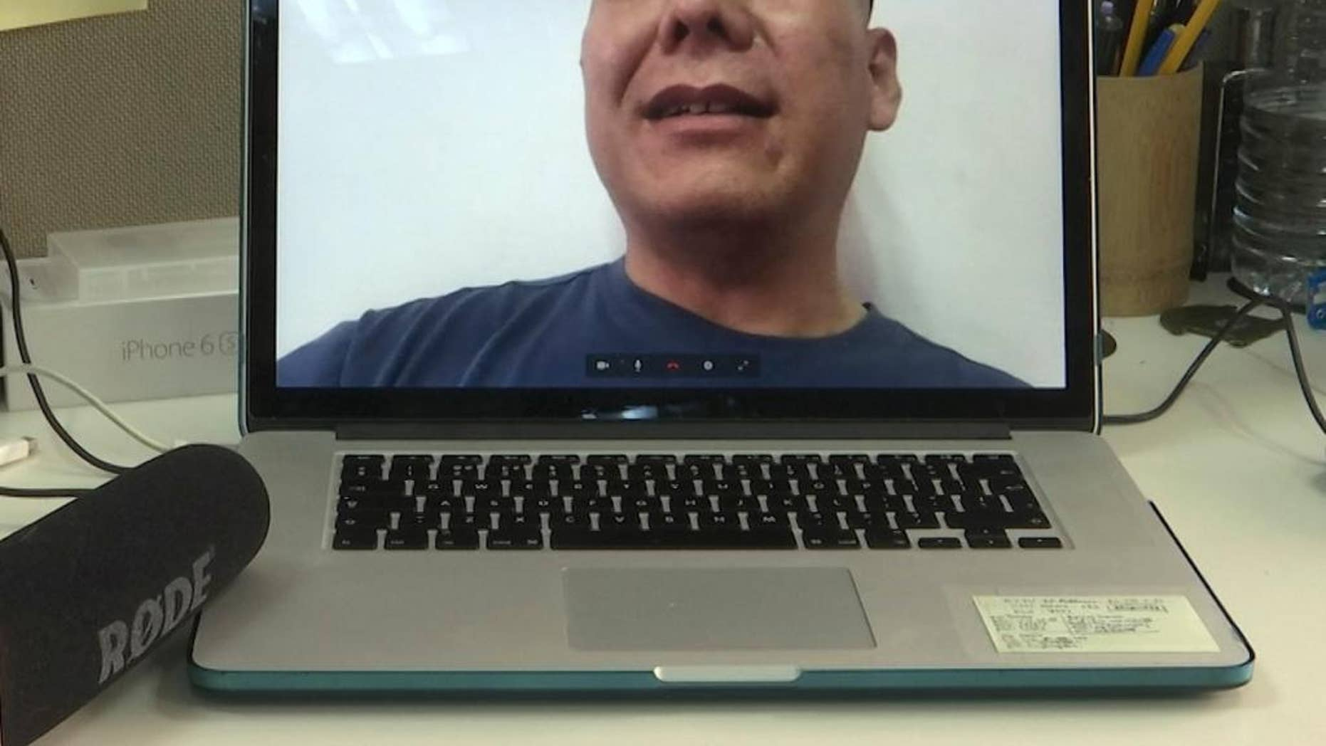 Chinese dissident Zhang Xiangzhong is seen on a computer screen during an interview via videoconference Monday, April 17, 2017, in Taipei, Taiwan. Zhang, who abandoned his tour group while in Taiwan, said he will apply for political asylum on Tuesday in hopes of staying on the self-governing island to promote democracy on the mainland. (AP Photo/Johnson Lai)