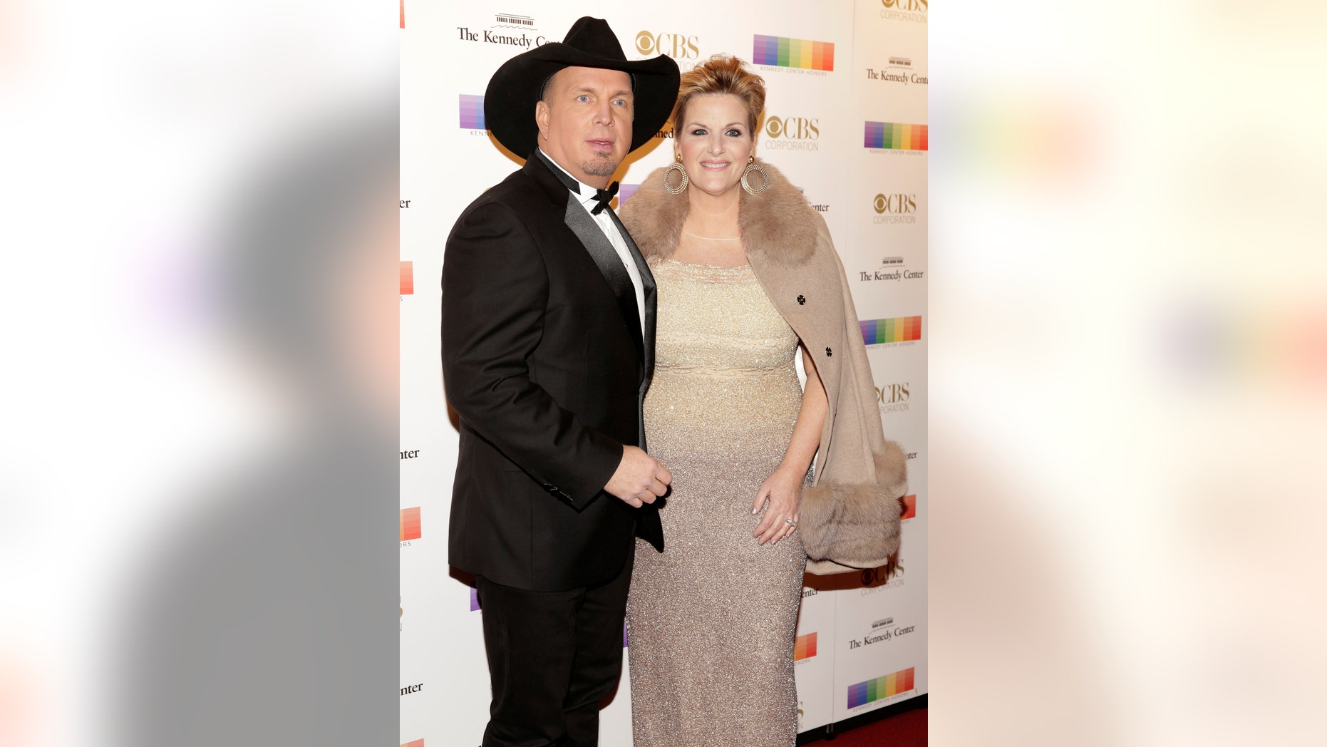 File photo: Musicians Garth Brooks and Tricia Yearwood arrives for the Kennedy Center Honors in Washington, U.S. December 4, 2016. (REUTERS/Joshua Roberts)