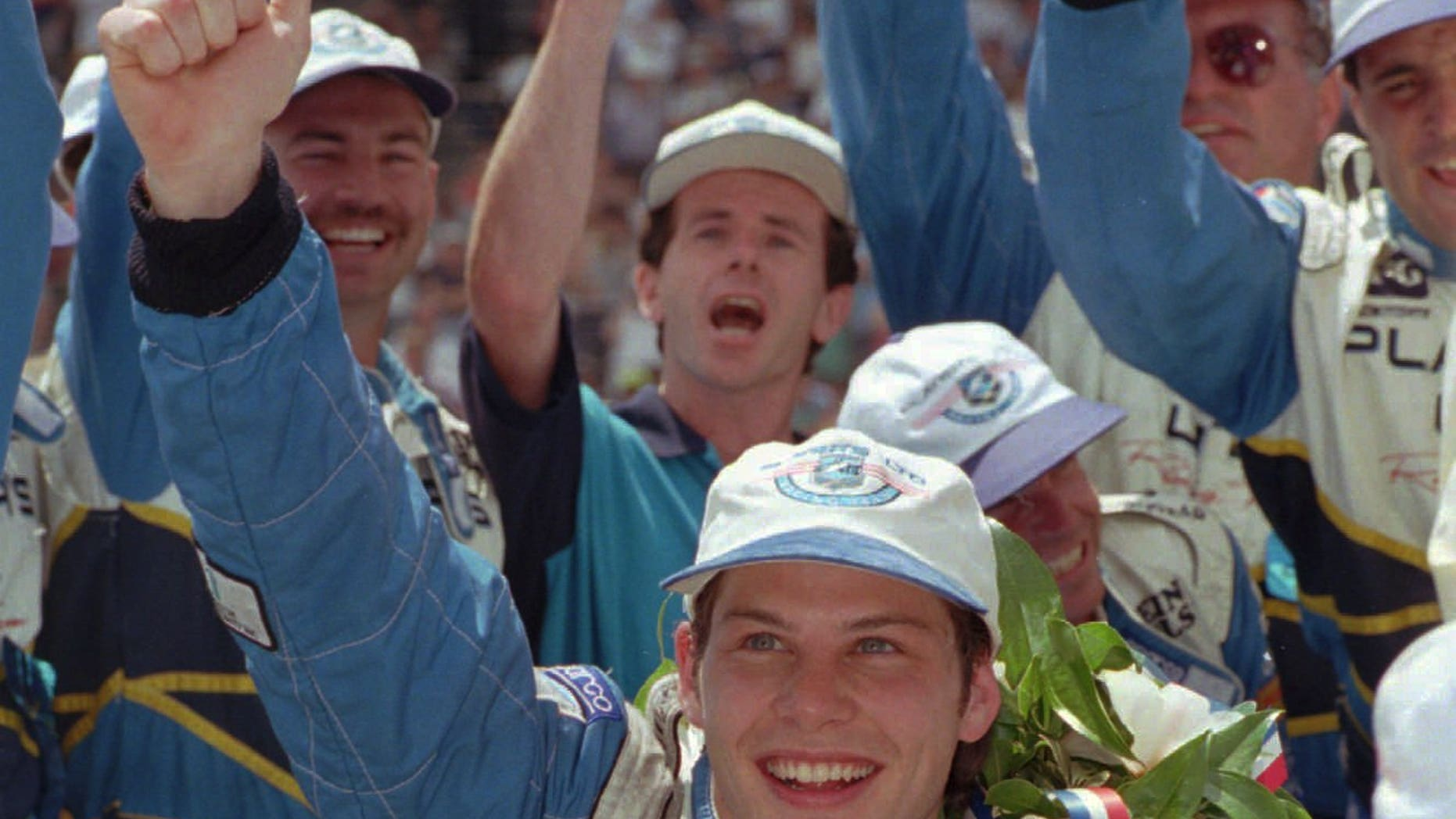 FILE - In this May 28, 1995 file photo, Jacques Villeneuve celebrates in Victory Lane after winning the Indianapolis 500 auto race in Indianapolis. Villeneuve is expected to finally compete for a second Indianapolis 500 crown. On Wednesday, Feb. 26, 2014, the 42-year-old Canadian driver is expected to be announced as a driver for Schmidt Peterson Motorsports this May. (AP Photo/Al Behrman, File)