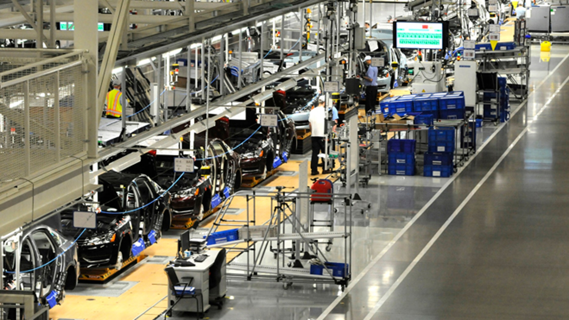 December 1, 2011:Volkswagen employees work on the assembly line of the 2012 VW Passat in Chattanooga, Tennessee.