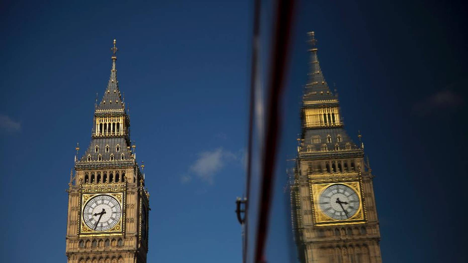 Elizabeth Tower, which houses the Big Ben bell, reflected in a bus window in London Tuesday.
