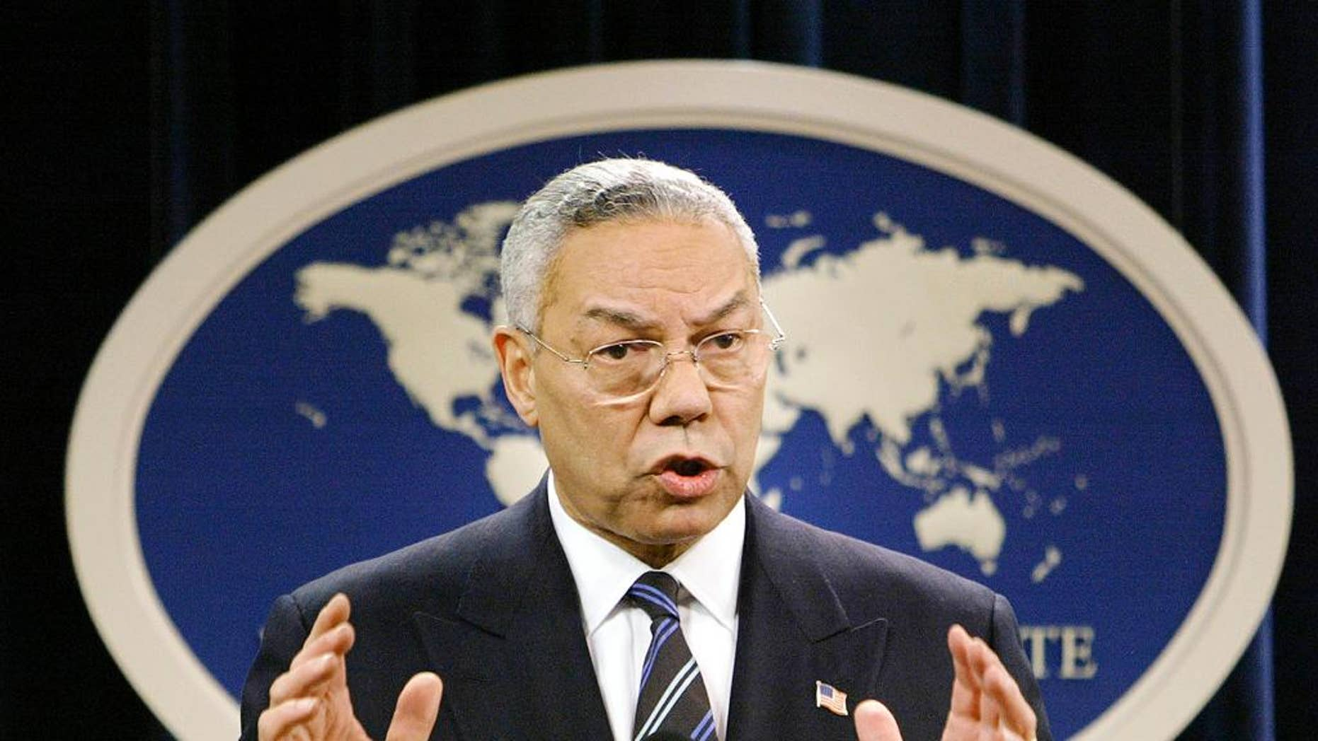 FILE - In this Jan. 8, 2004, file photo, then-Secretary of State Colin Powell speaks at a news conference in Washington at the State Department. A document circulating among White House staff says a Senate report on the CIA's interrogation and detention practices after the 9/11 attacks concludes that the agency initially kept Powell and some U.S. ambassadors in the dark about harsh techniques and secret prisons. (AP Photo/J. Scott Applewhite, File)