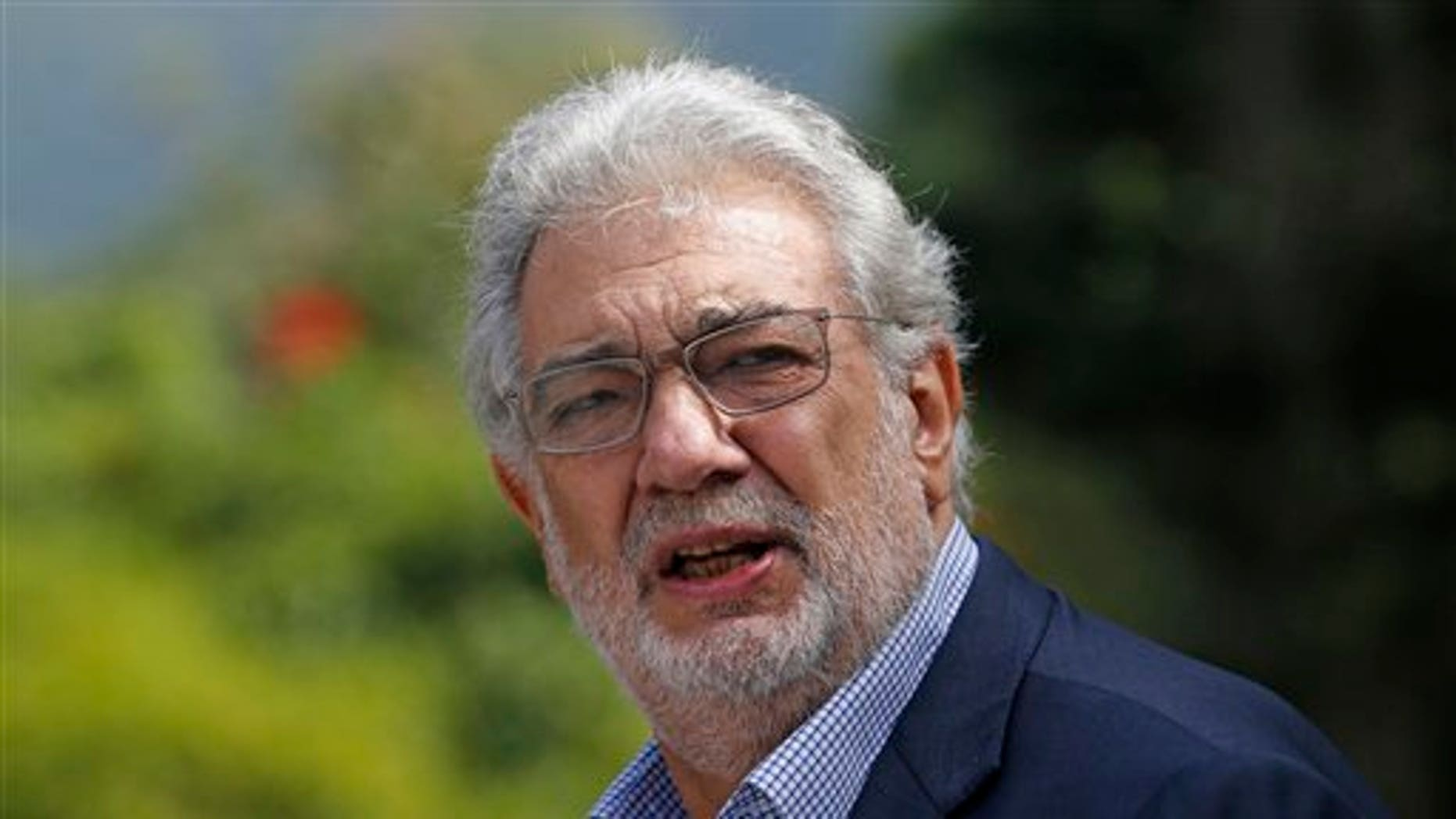 Tenor Placido Domingo gestures after a press conference in Rio de Janeiro, Brazil, Thursday, July 3, 2014. For Placido Domingo, opera and soccer go hand in hand. The Spanish tenor has performed during almost every World Cup since 1990 and plans a July 11 concert in Rio de Janeiro, just two days before the city hosts the final game. (AP Photo/Silvia Izquierdo)