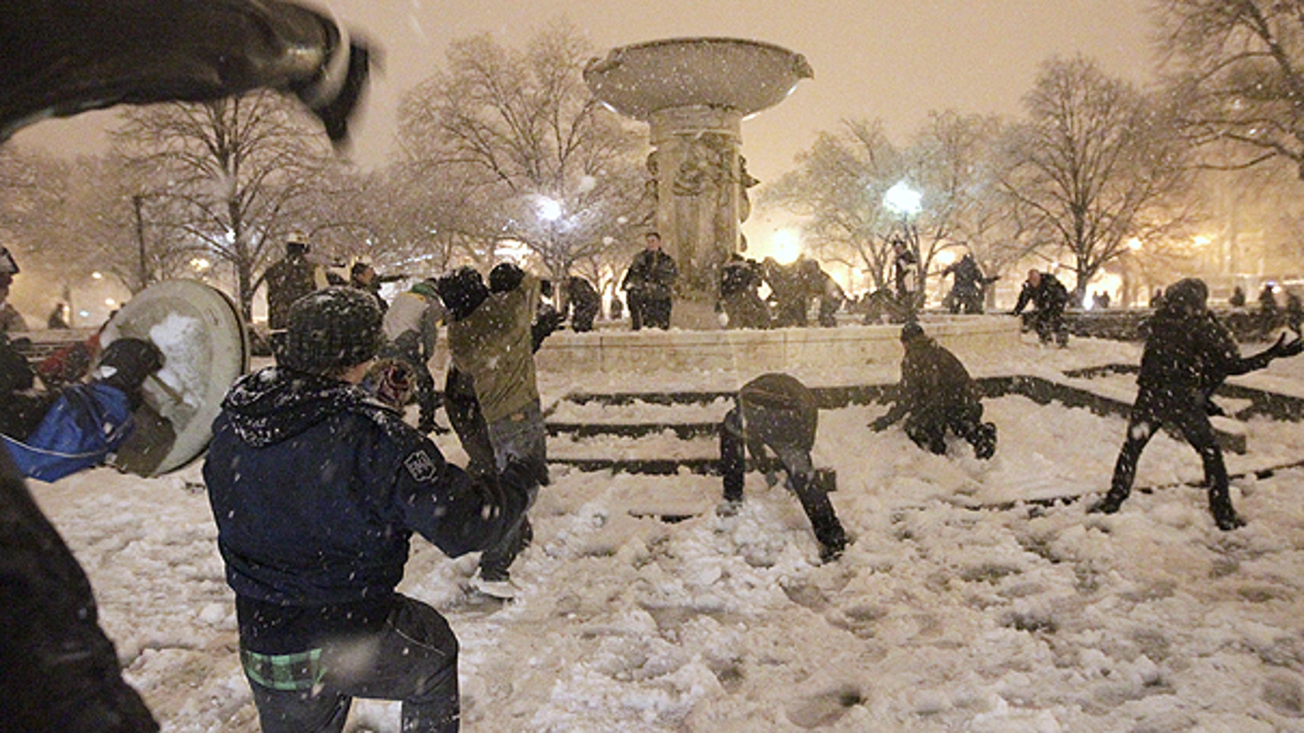 Jan. 26: A snowball fight breaks out at Dupont Circle in Washington in the still-falling snow.